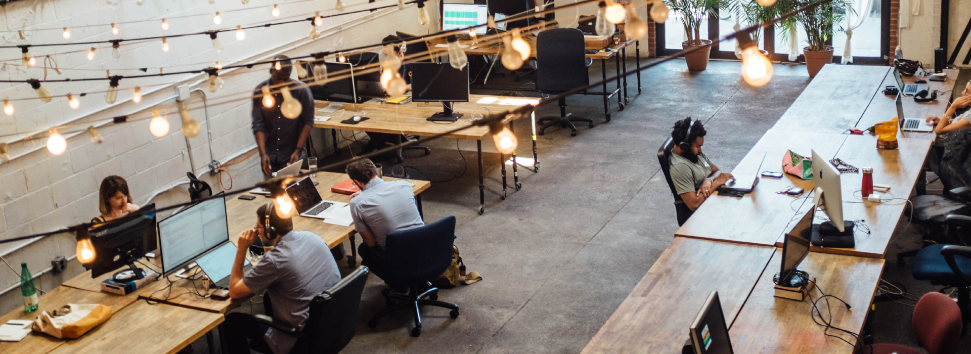 Coworking Space with wooden tables and people working