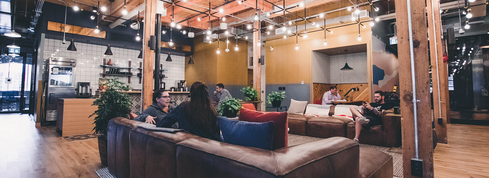 people sitting in the lounge at WeWork in Toronto, Canada