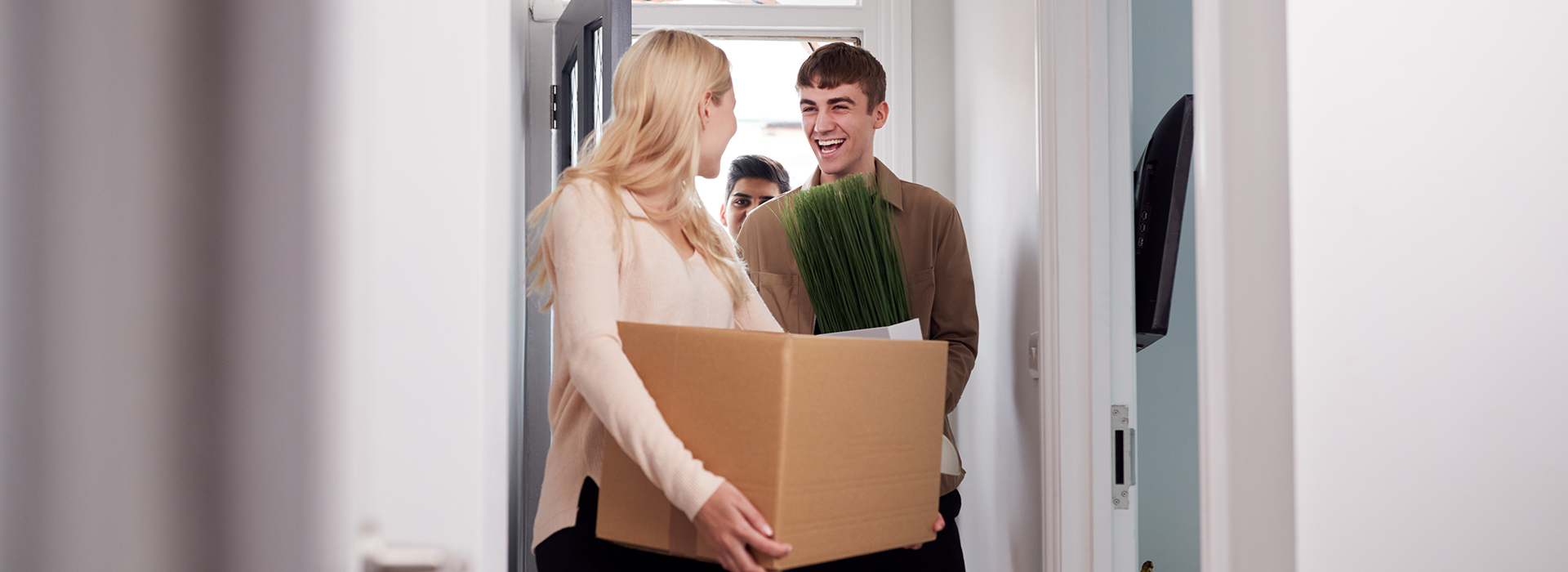 blonde girl with paper box moving in with her boyfriend