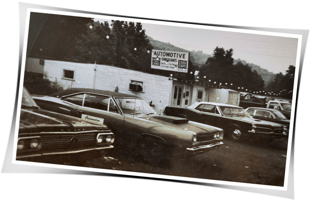 Photo of Automotive Consultants Car Lot in the 1960s taken by owner William Card
