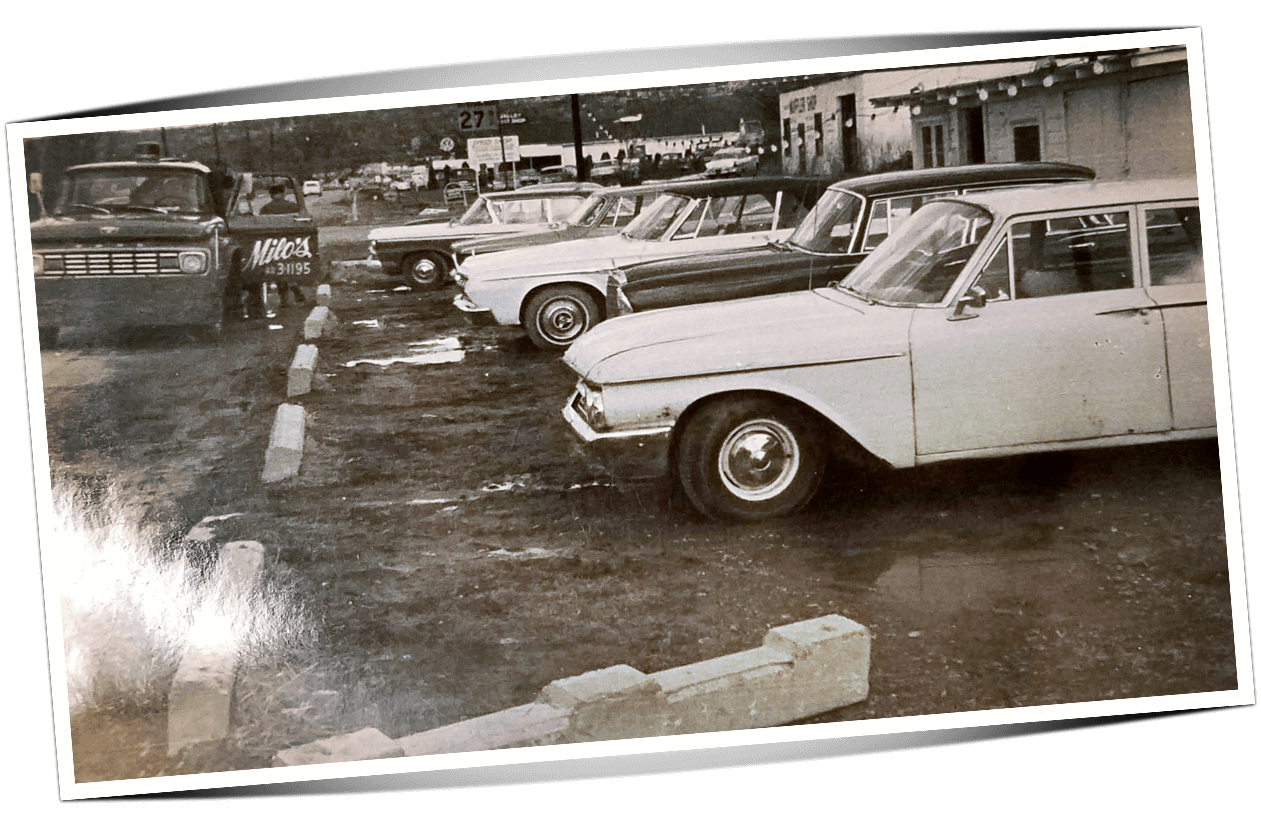 Photo of used cars for sale at Automotive Consultants car lot in 1960s