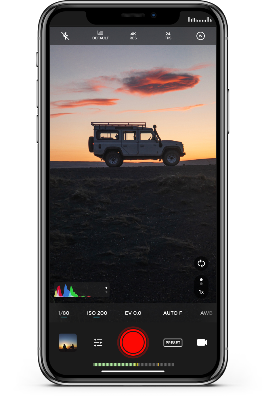 The Moment Pro Camera App on an iPhone X, taking a video of a Land Rover at sunset.