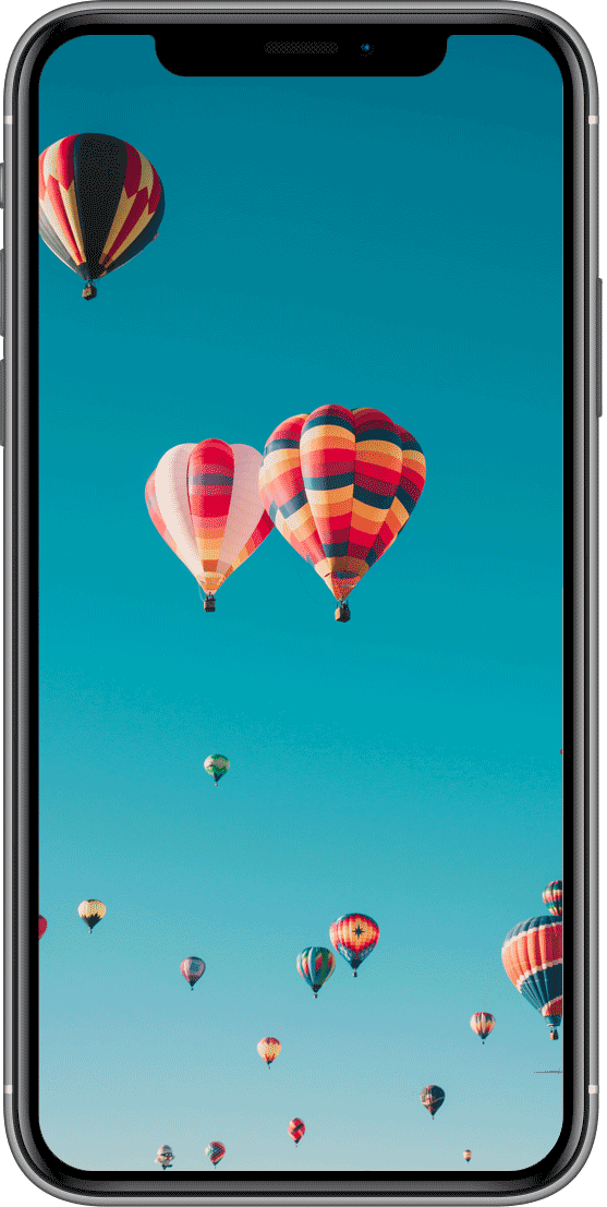 iPhone displaying multiple hot-air balloons in front of a blue sky.