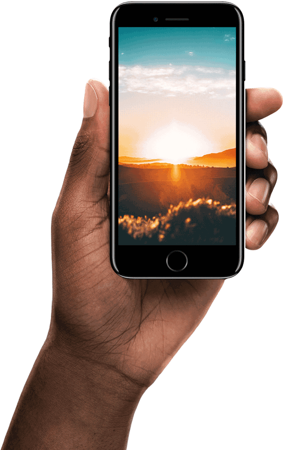 A hand holding an iPhone showing a sunset.