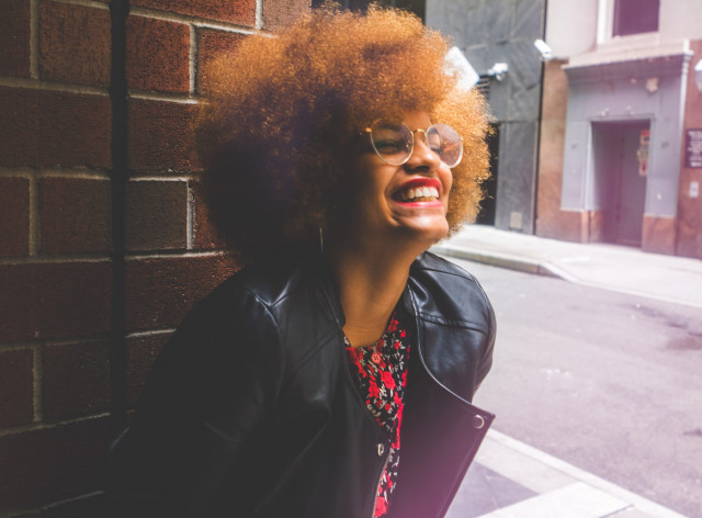 black woman with afro laughing