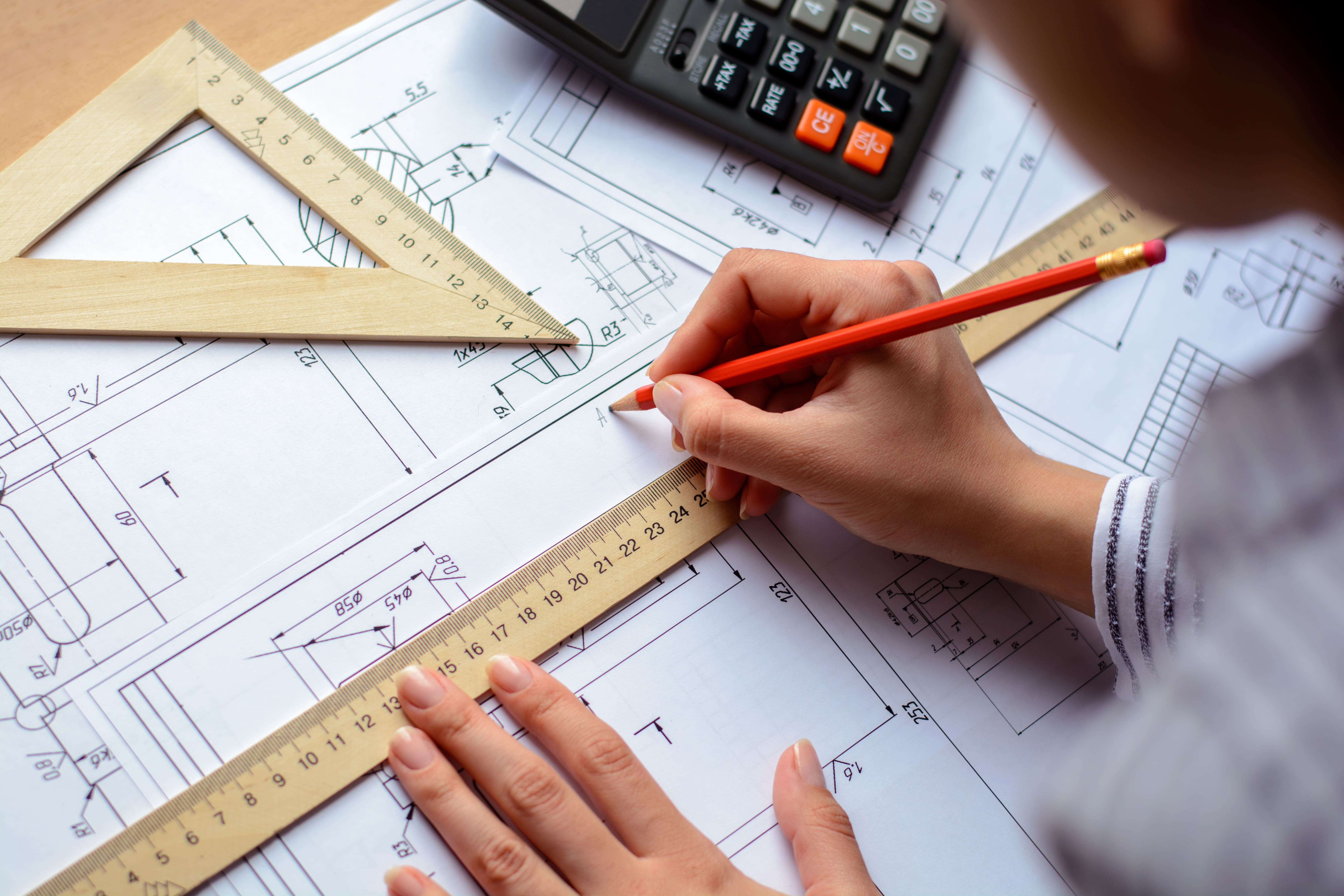 Architect with his hands over blueprint