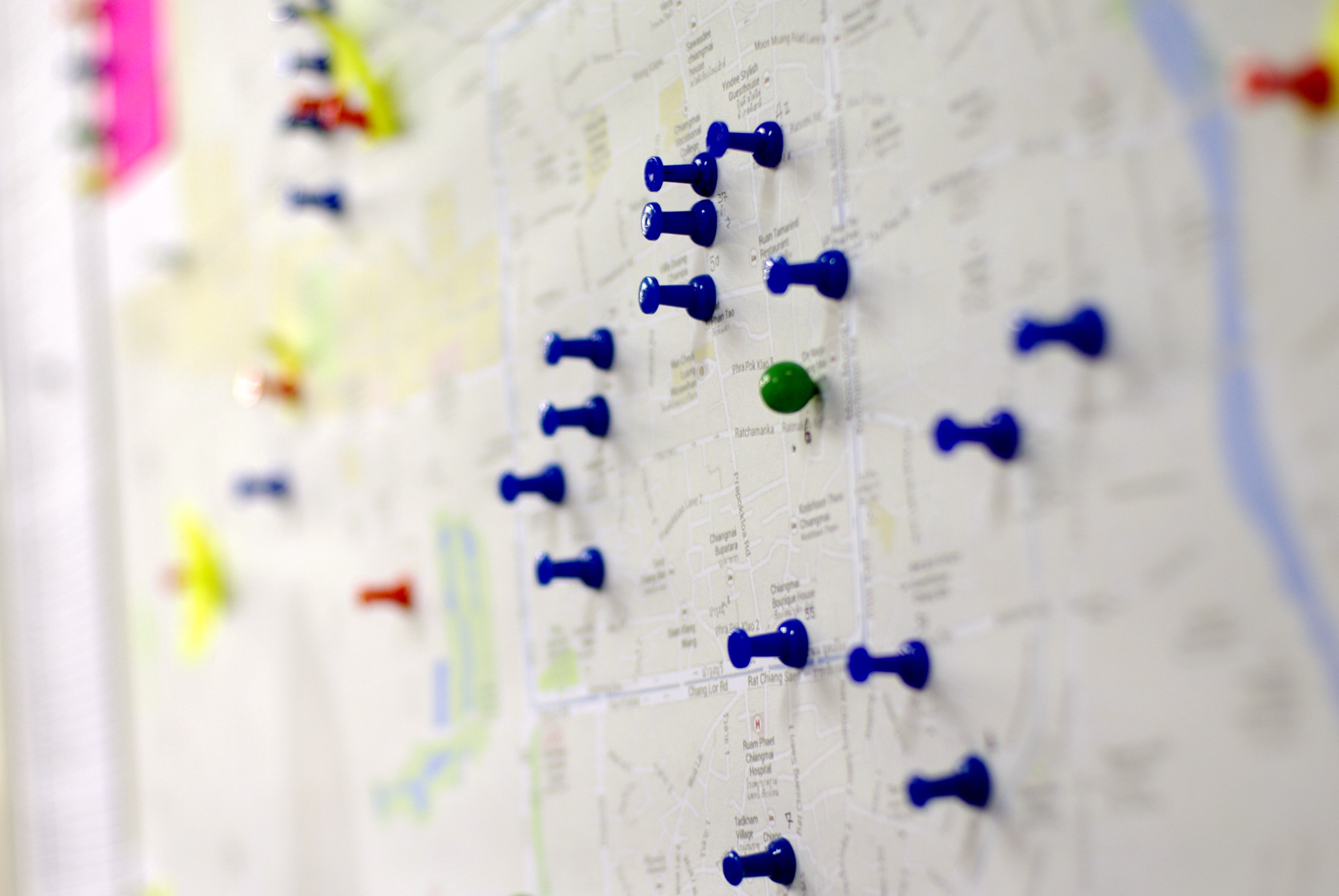 Map with pins pinned to random locations.