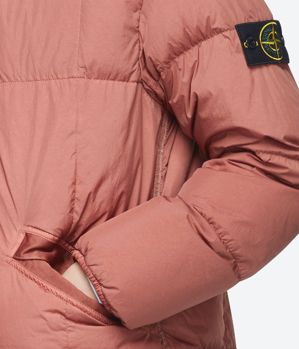 Coral pink stone island jacket close up shot for eCommerce