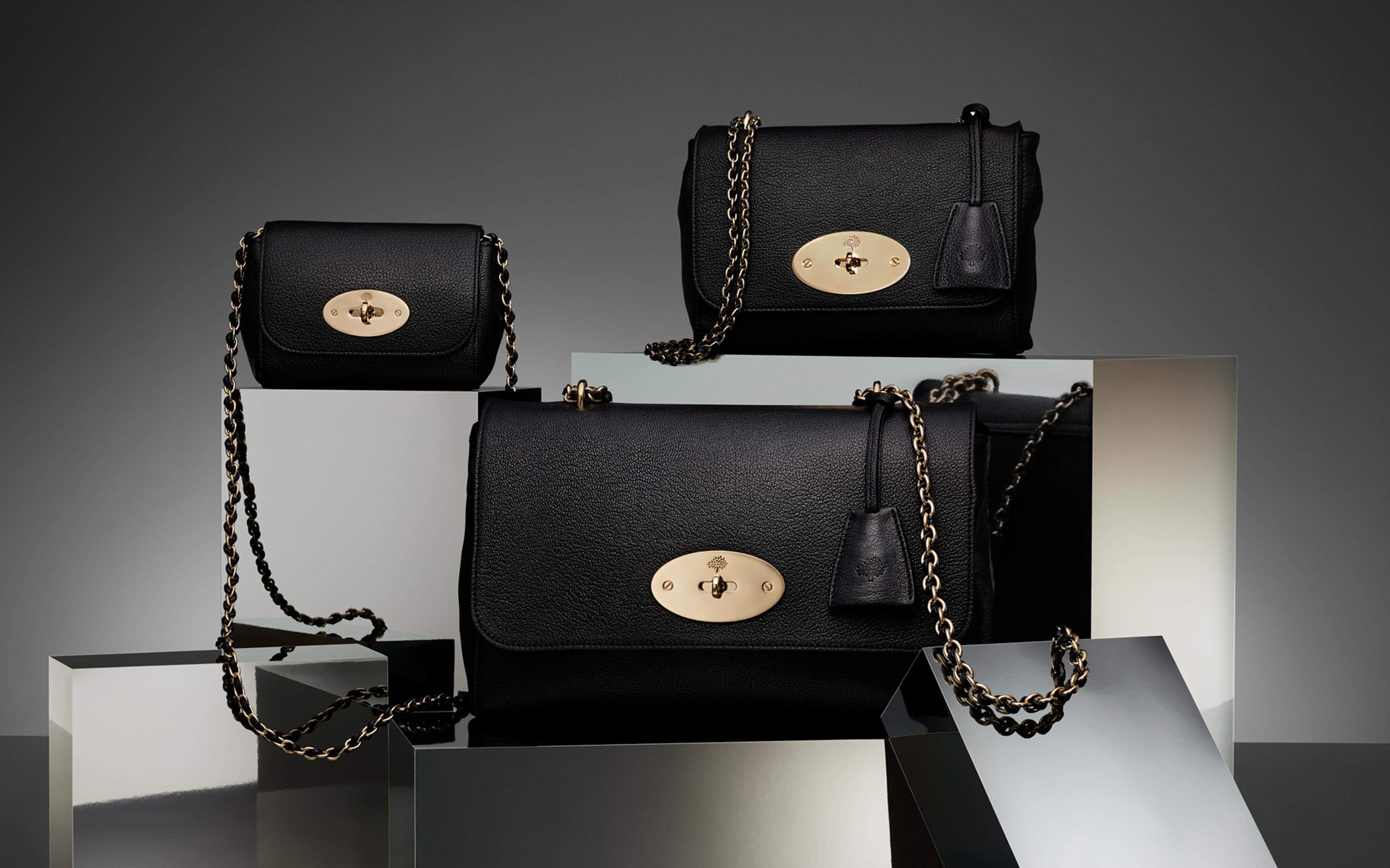three mulberry black leather bags on display
