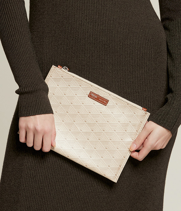 close up shot of a Woman model showing small handbag with brown dress