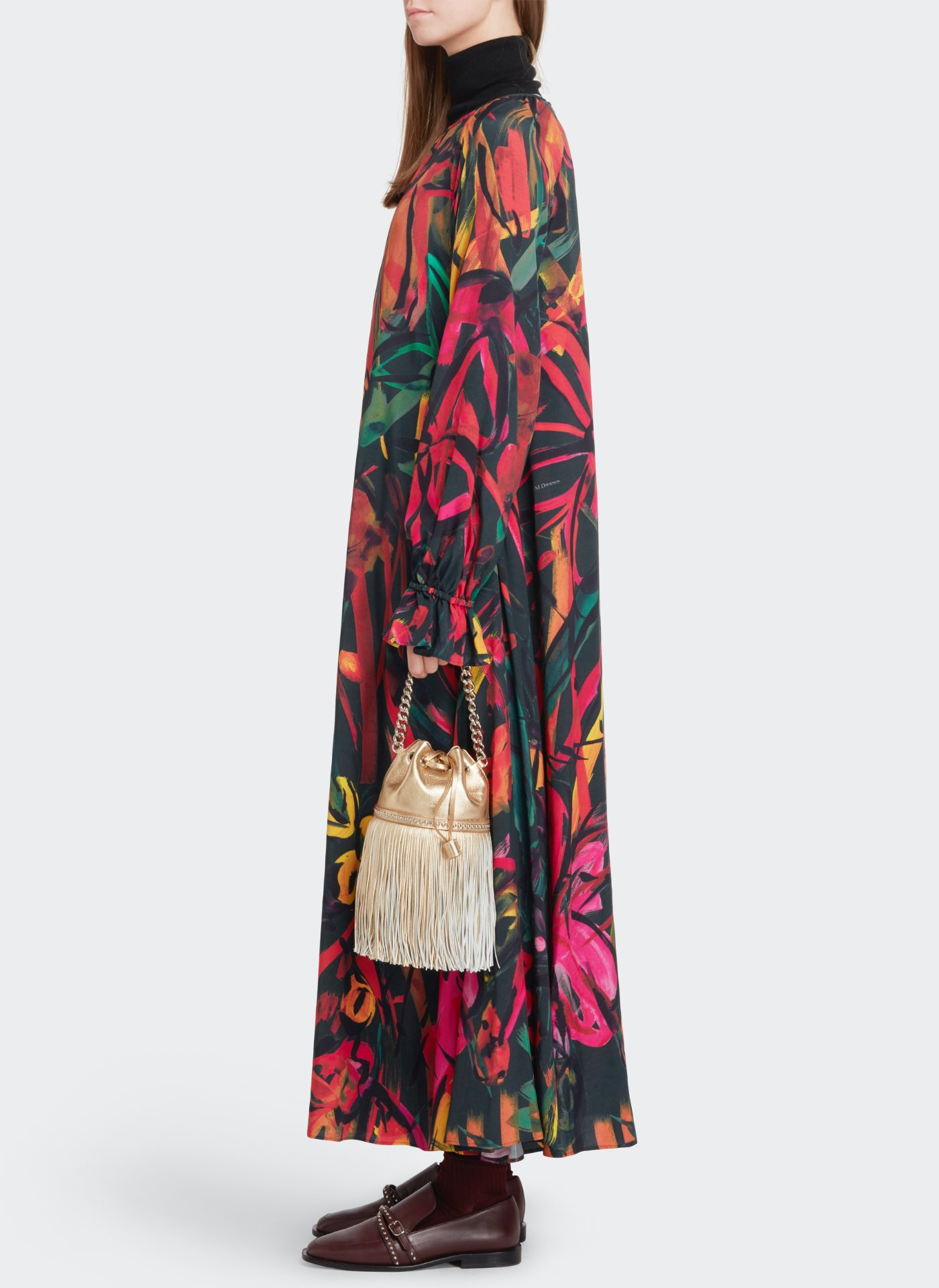 model with a J&M long multi colour dress with pale sand leather bag