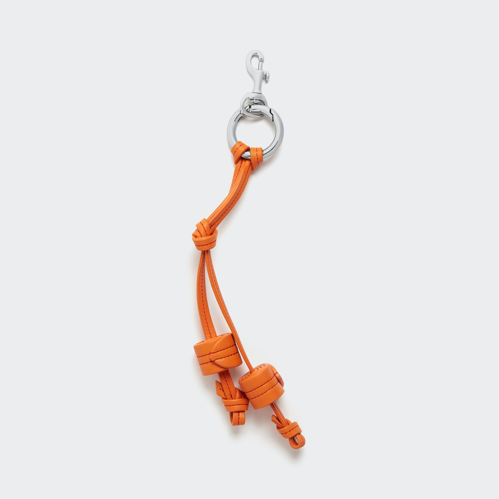 leather keyring in orange with a silver/steel  loop