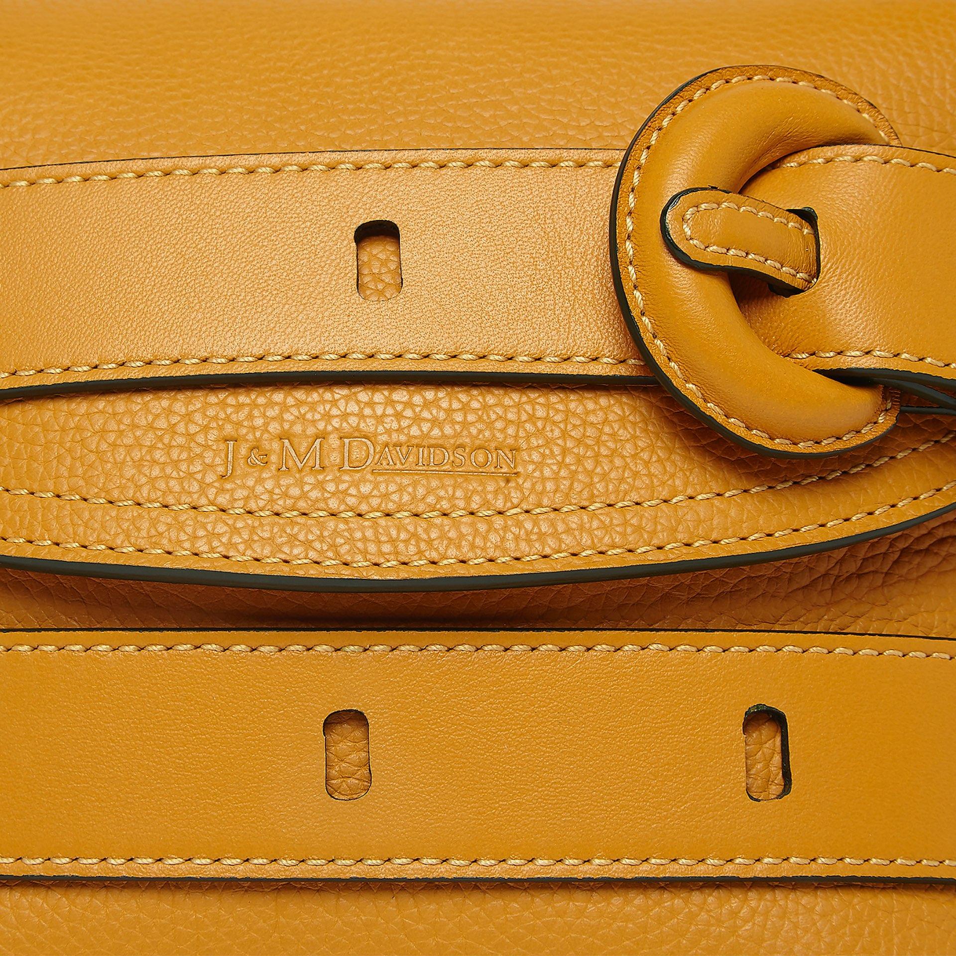 close up shot of J&M mustard yellow small handbag