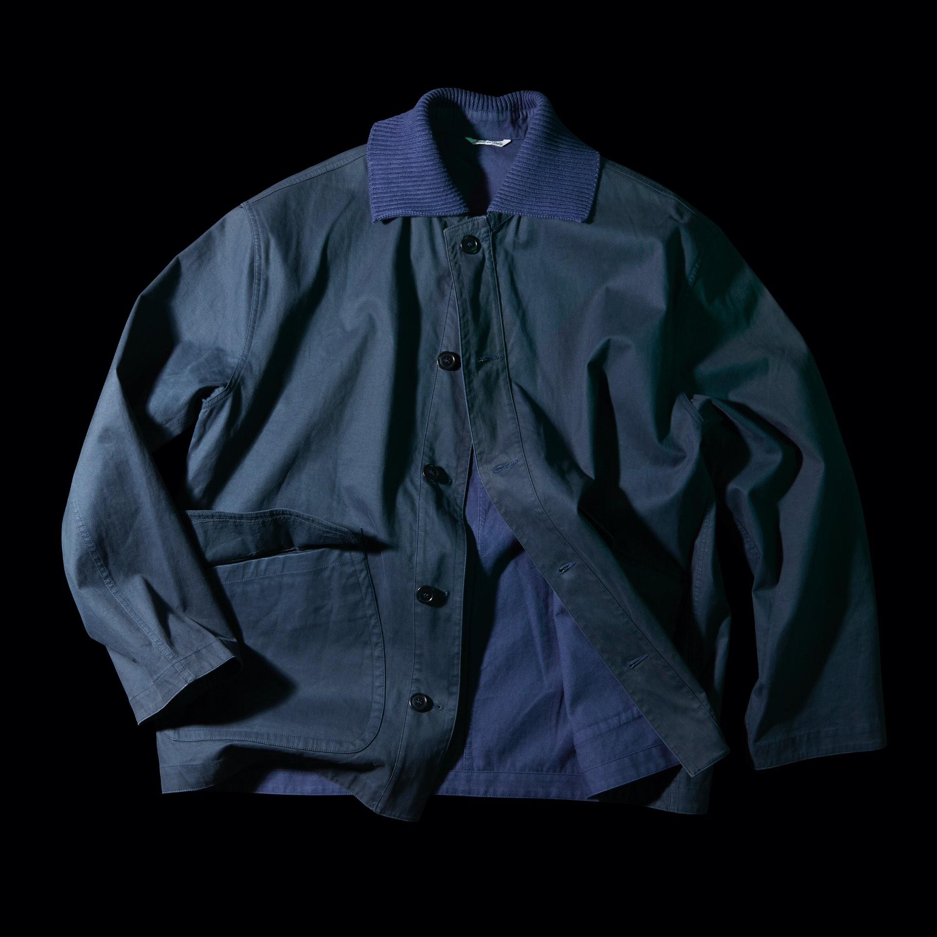 Blue C.P. Company jacket black background