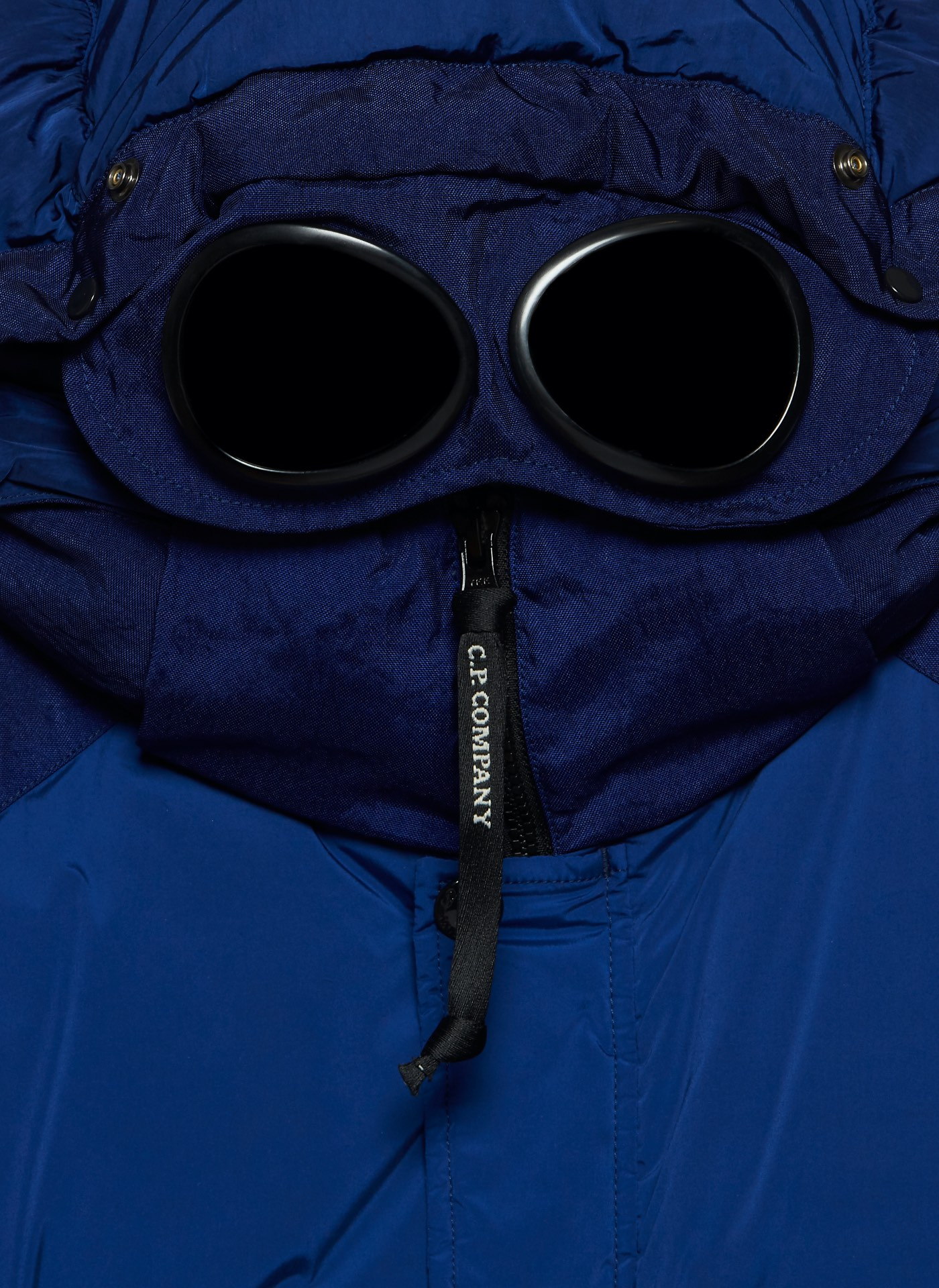 Blue C.P. Company jacket hoodie with iconic eye patches