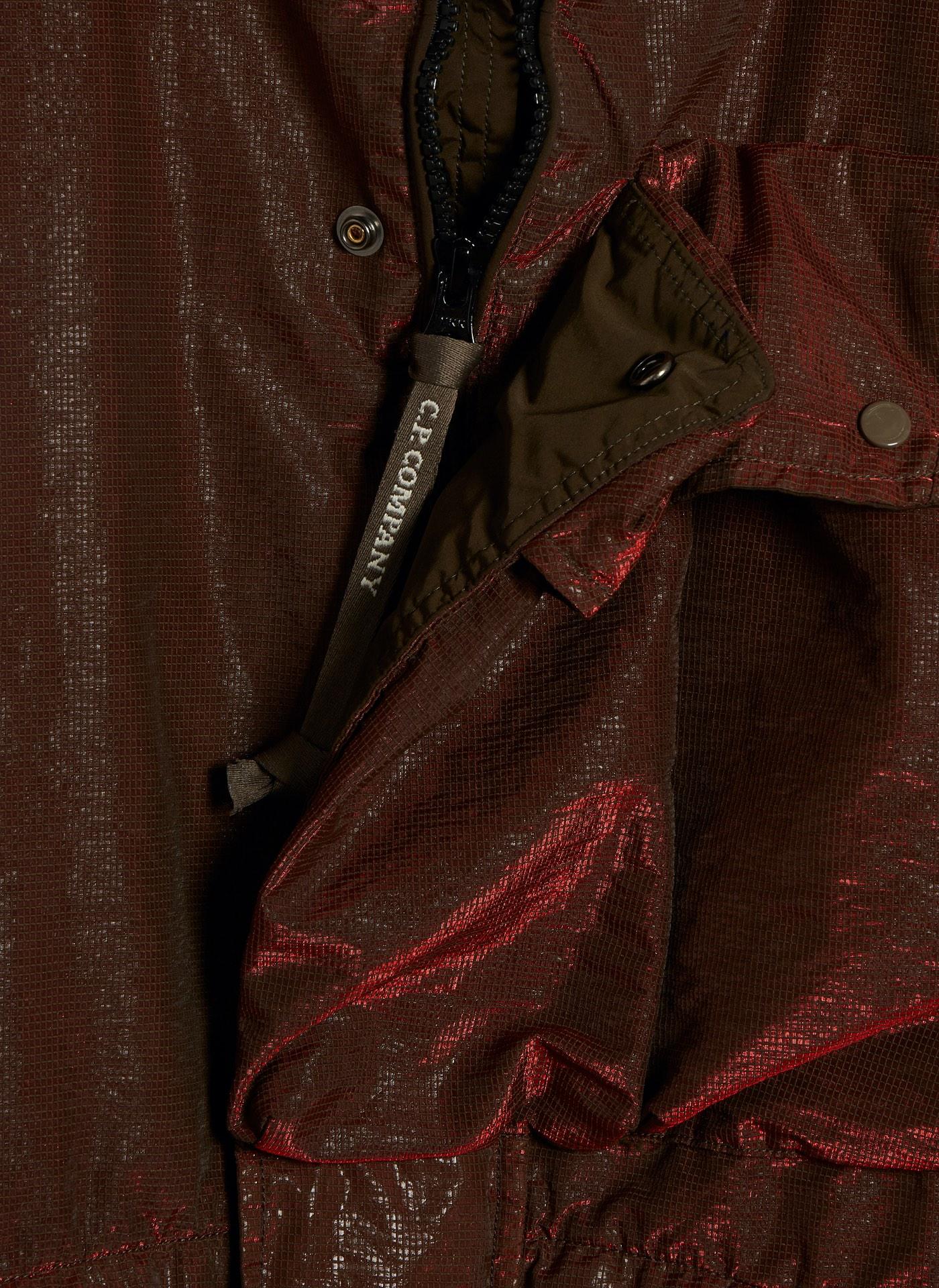 detail shot of a burgundy C.P. Company rain coat