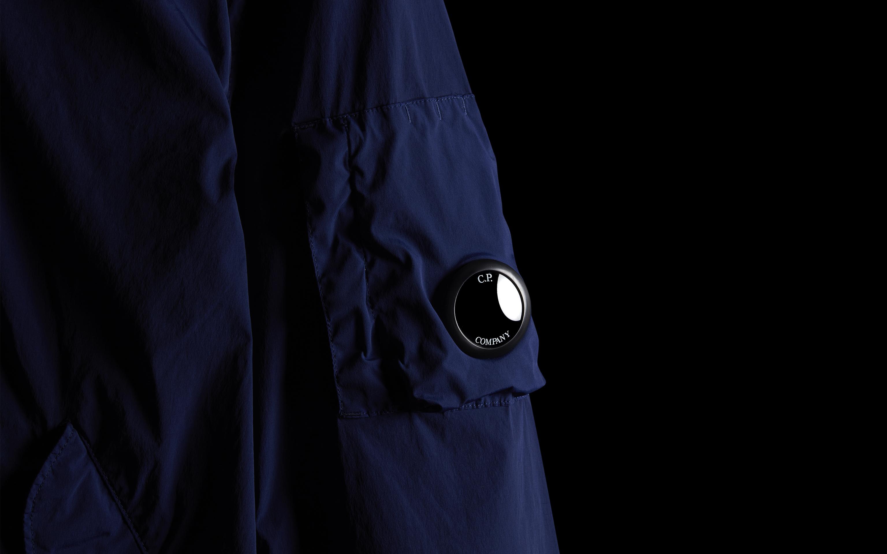 C.P. Brand blue jacket shot in the black background