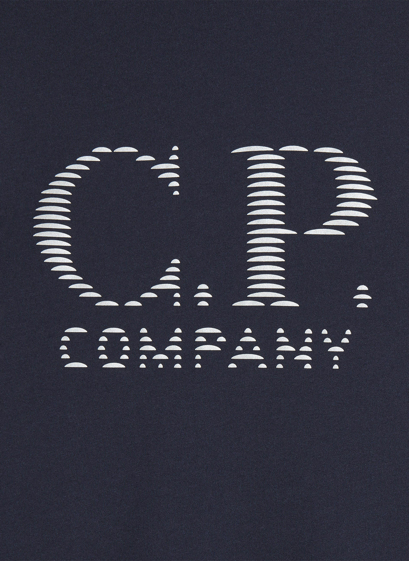 C.P. company logo embroidered in white on dark navy blue textile