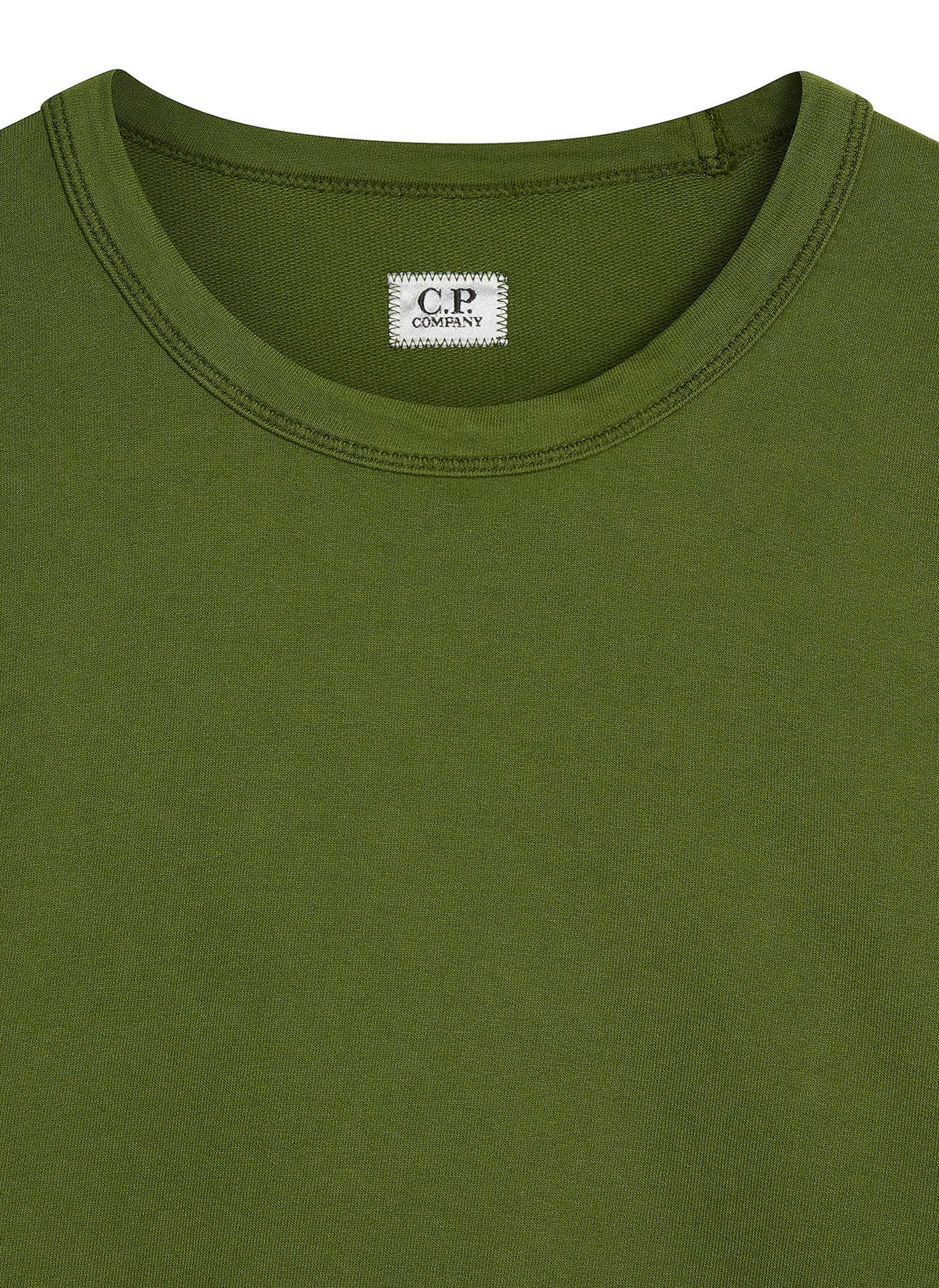 Green C.P. Company jumper detail shot of the label and collar