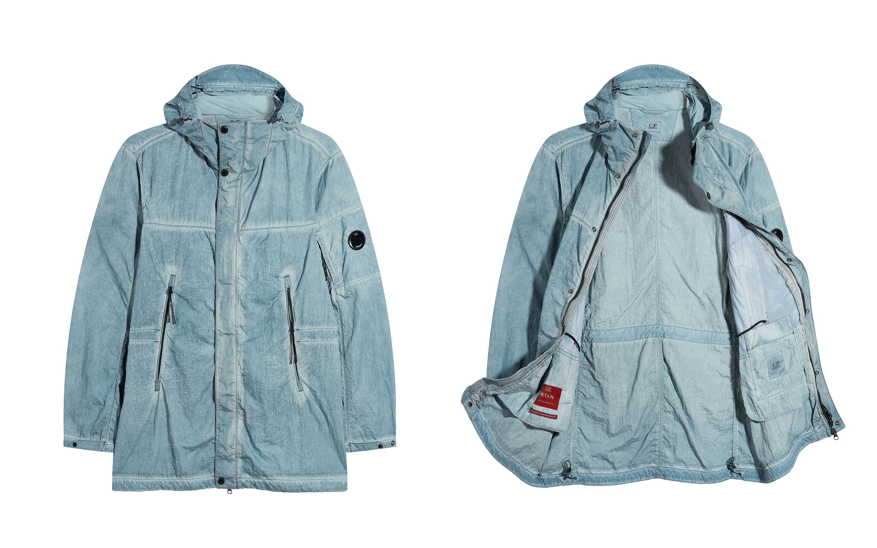 Picture of two bright blue colour C.P. Company raincoats one open and the other closed, both on white background