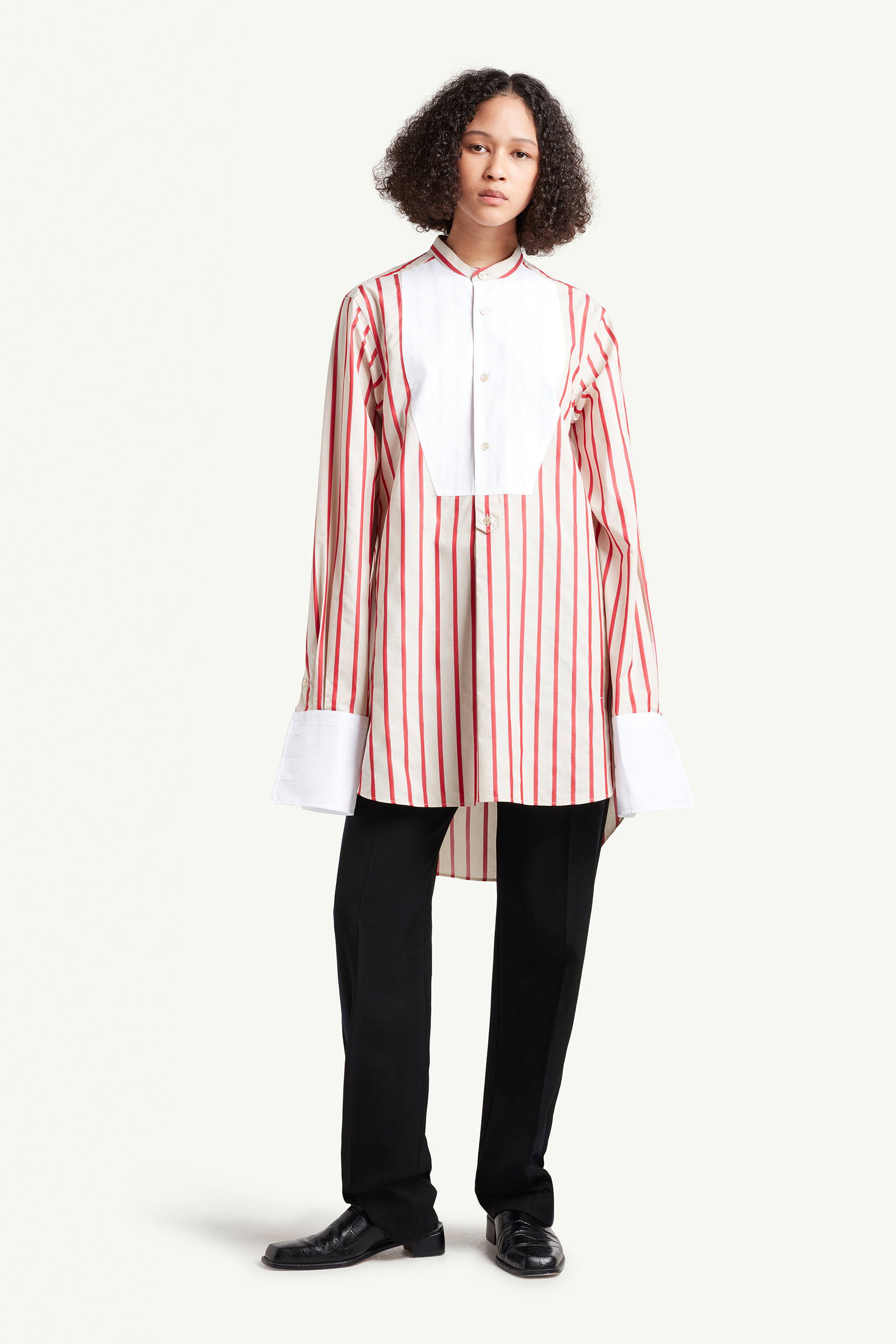 Wales Bonner Womenswear Model wearing a red striped long shirt | LRP