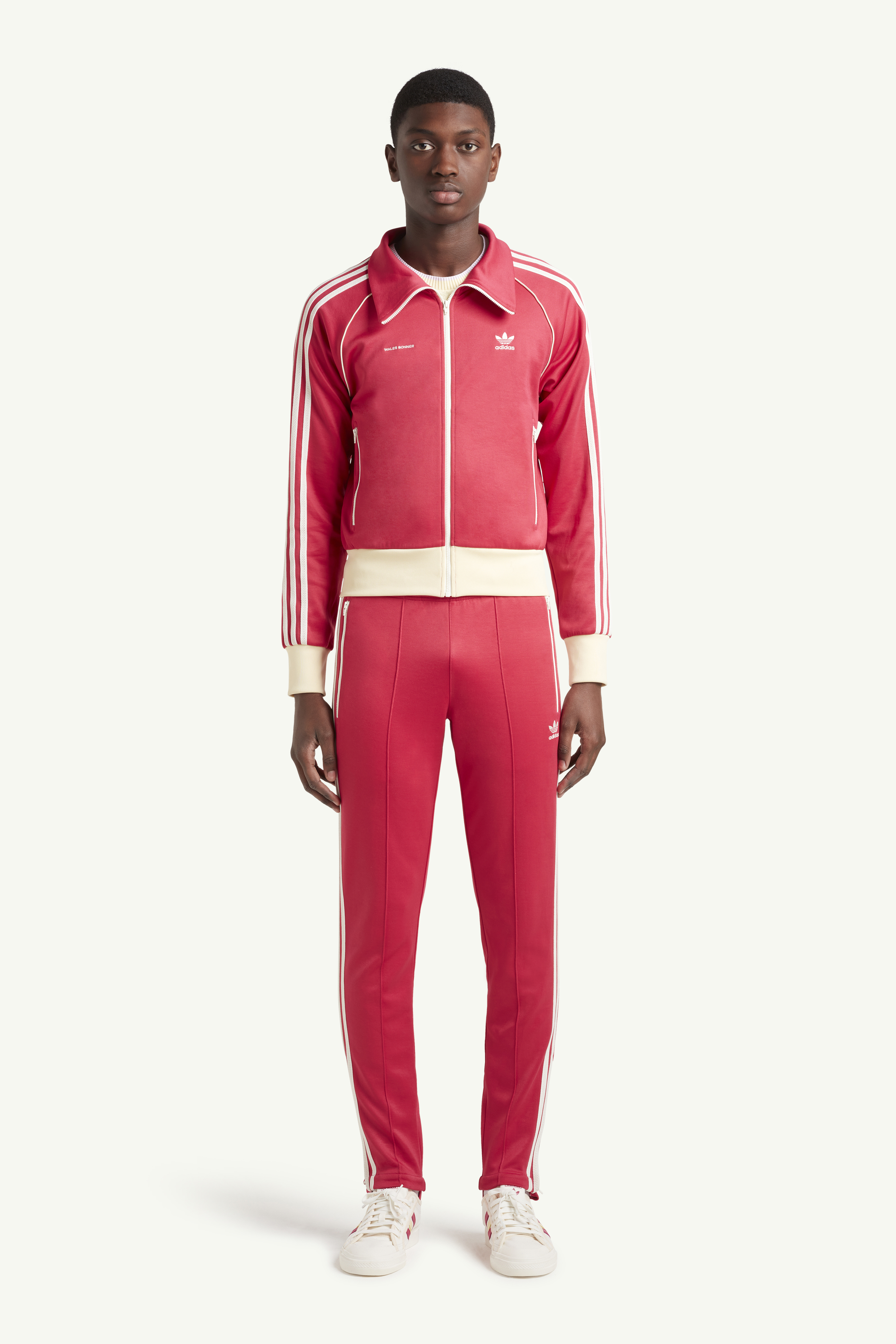 Menswear model wearing Wales Bonner Bright red sweat suit with white trainers | LRP