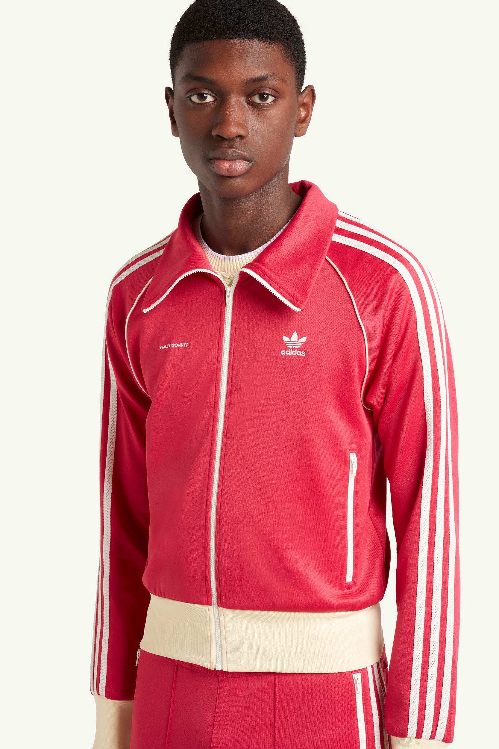 Closeup shot of Menswear model wearing Wales Bonner Bright red sweat suit with white trainers | LRP