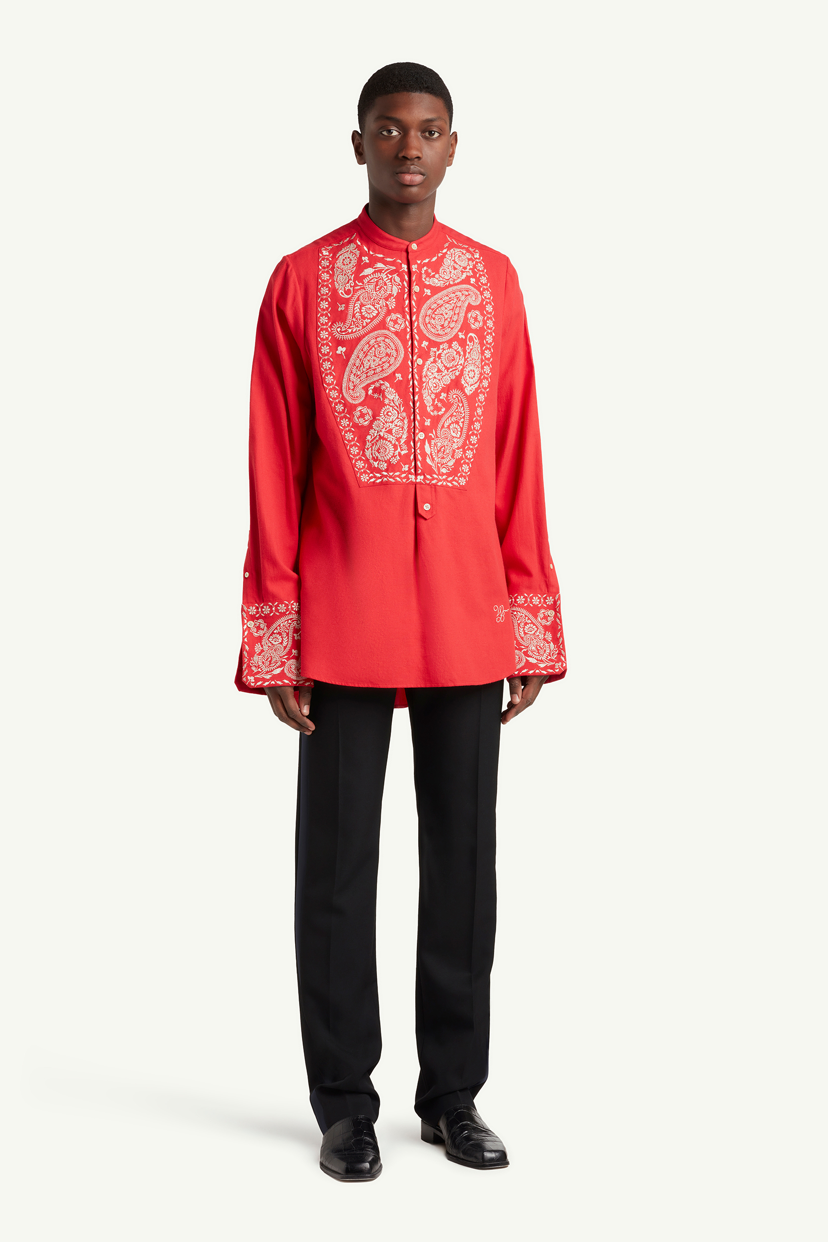 Menswear model wearing Wales Bonner red shit with white ornaments and black smart trousers | LRP