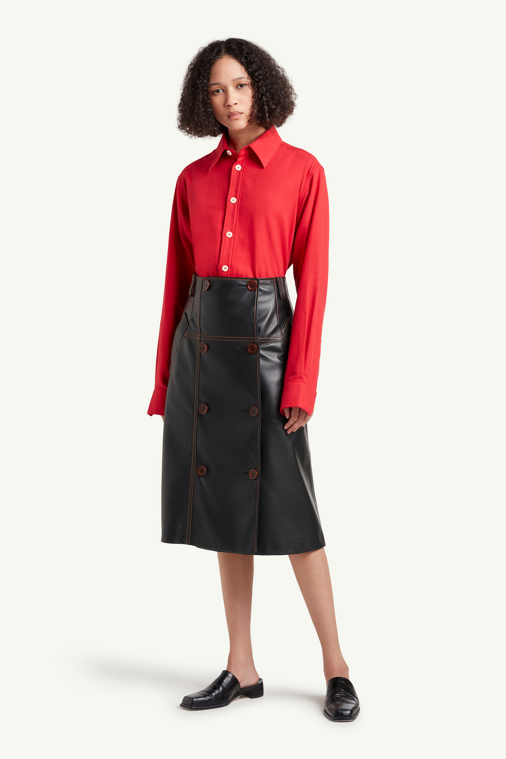 Wales Bonner Menswear Model wearing a red shirt and leather skirt | LRP