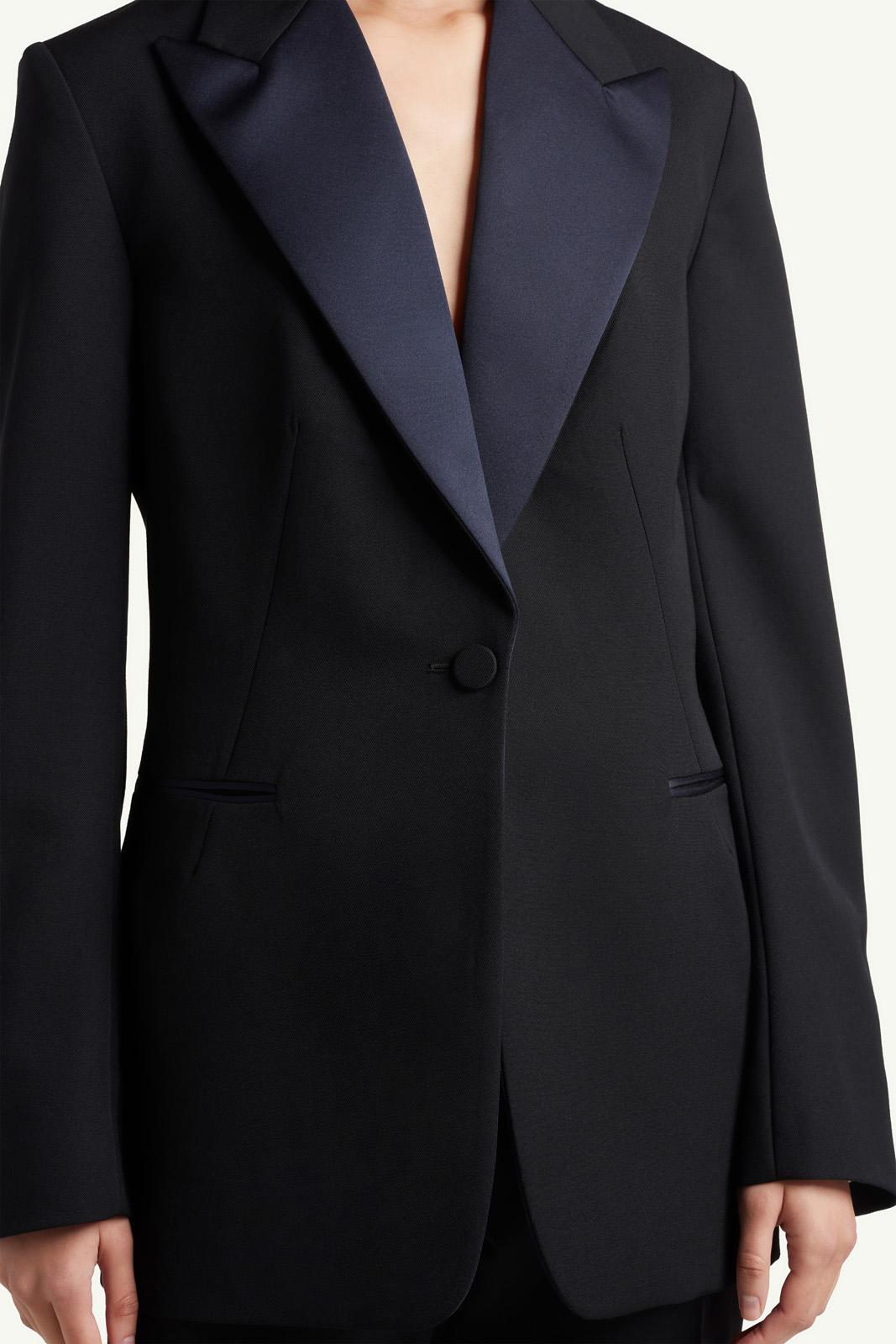 Detail shot of Womenswear model wearing  black Wales Bonner suit