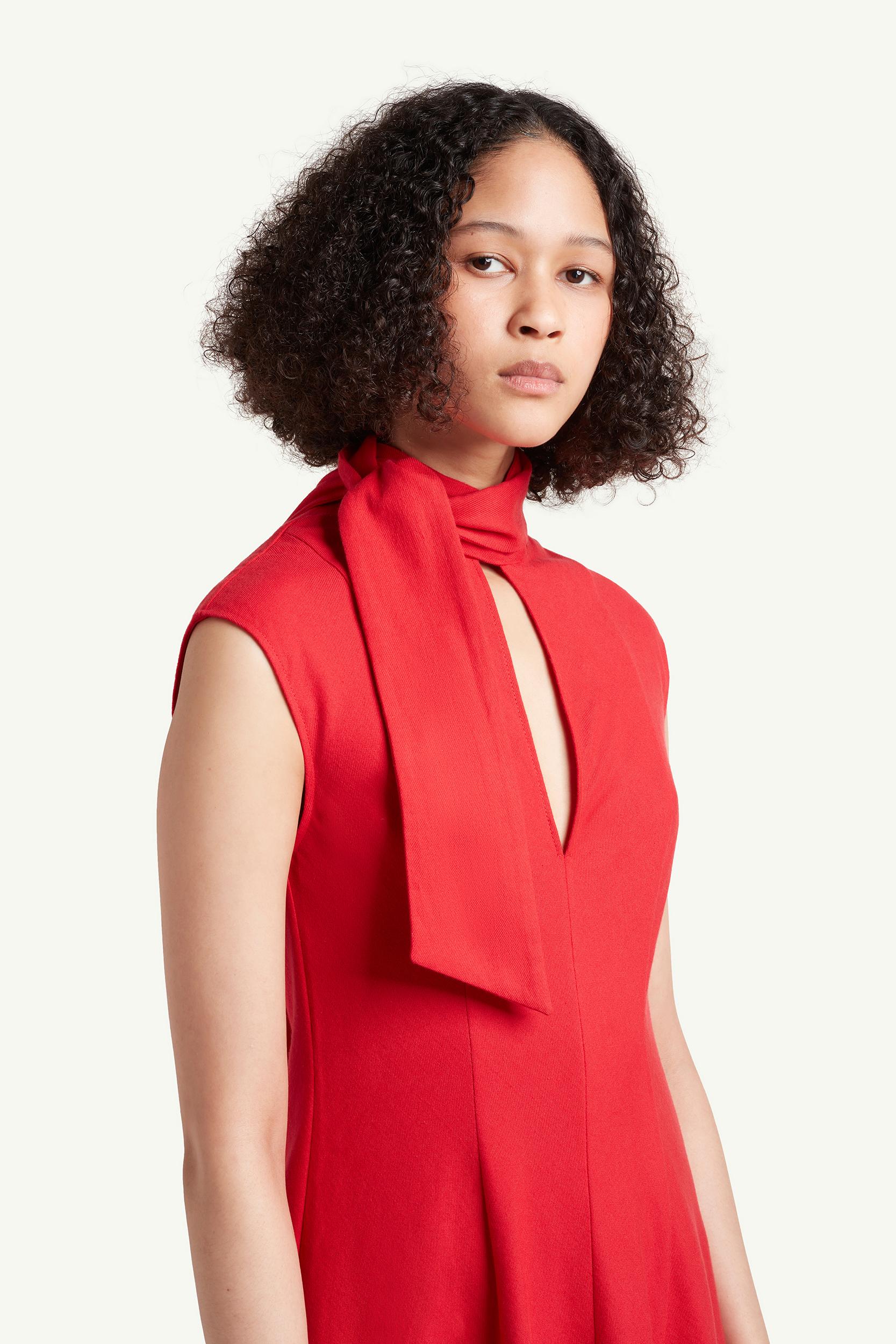 detail shot of Womenswear model wearing red Wales Bonner dress | LRP