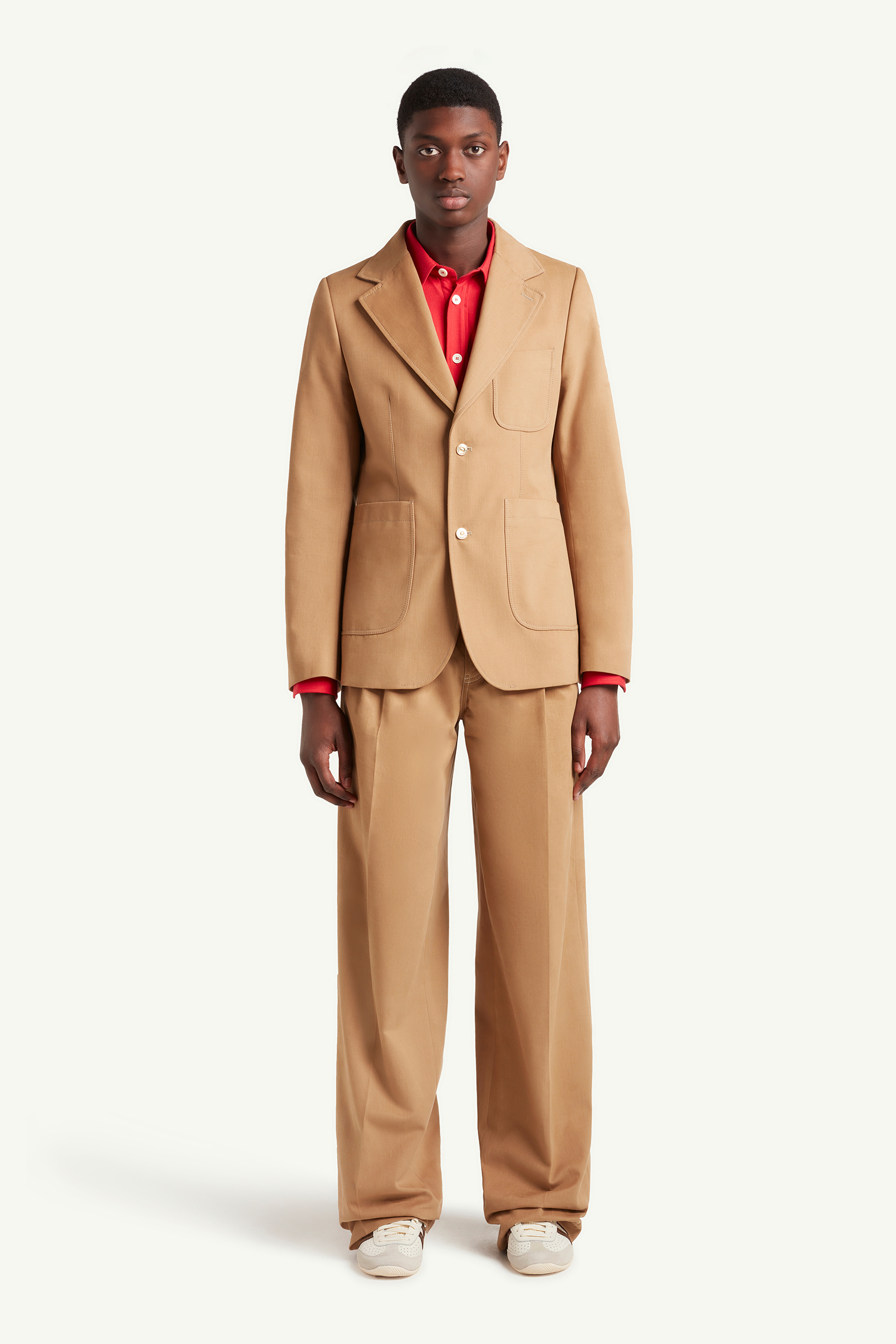 Menswear model wearing sand Wales Bonner suit with red shirt and white trainers | LRP