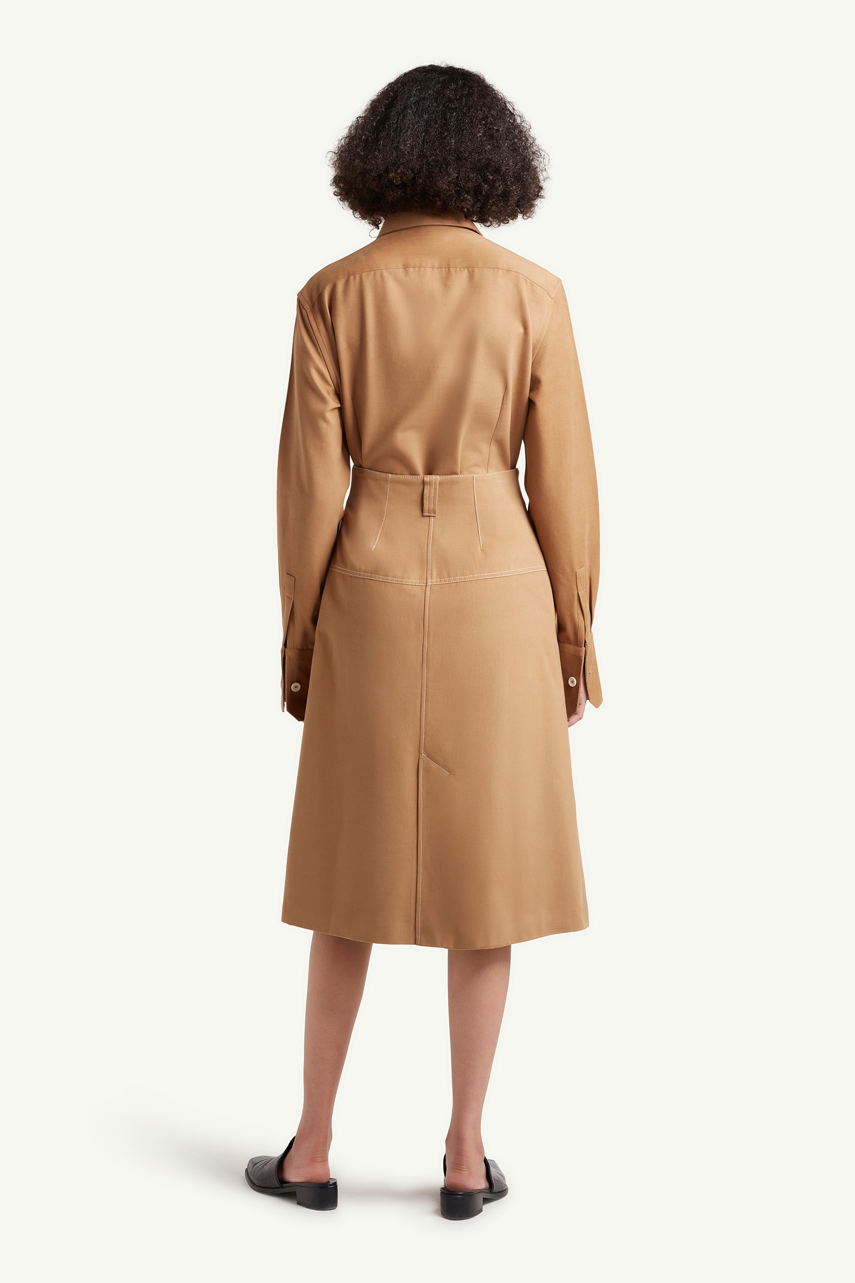 Back shot of the Womenswear model wearing light brown Wales Bonner dress with white buttons | e-Commerce Photography London | LRP