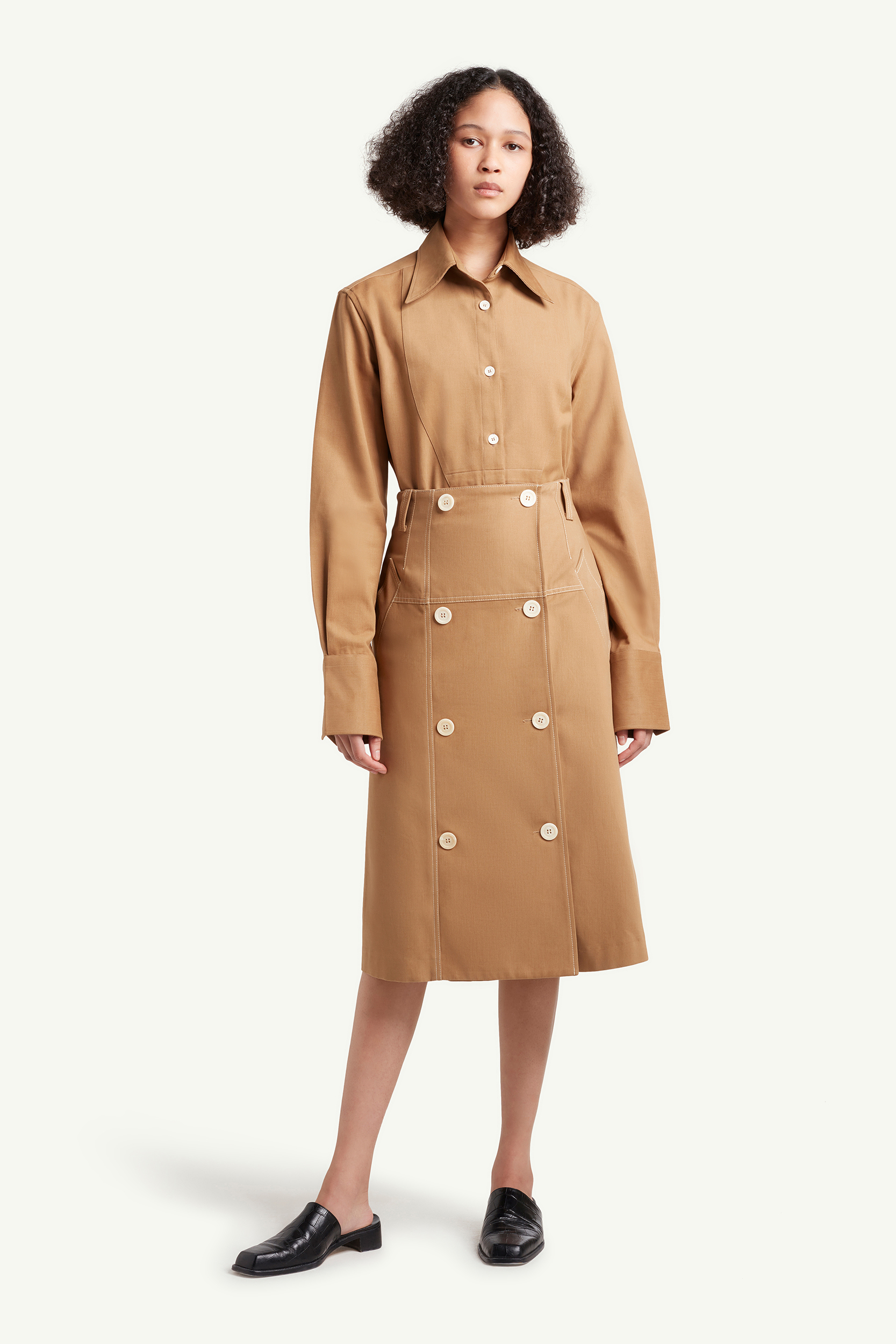 Womenswear model wearing light brown Wales Bonner dress with white buttons | e-Commerce Photography London | LRP