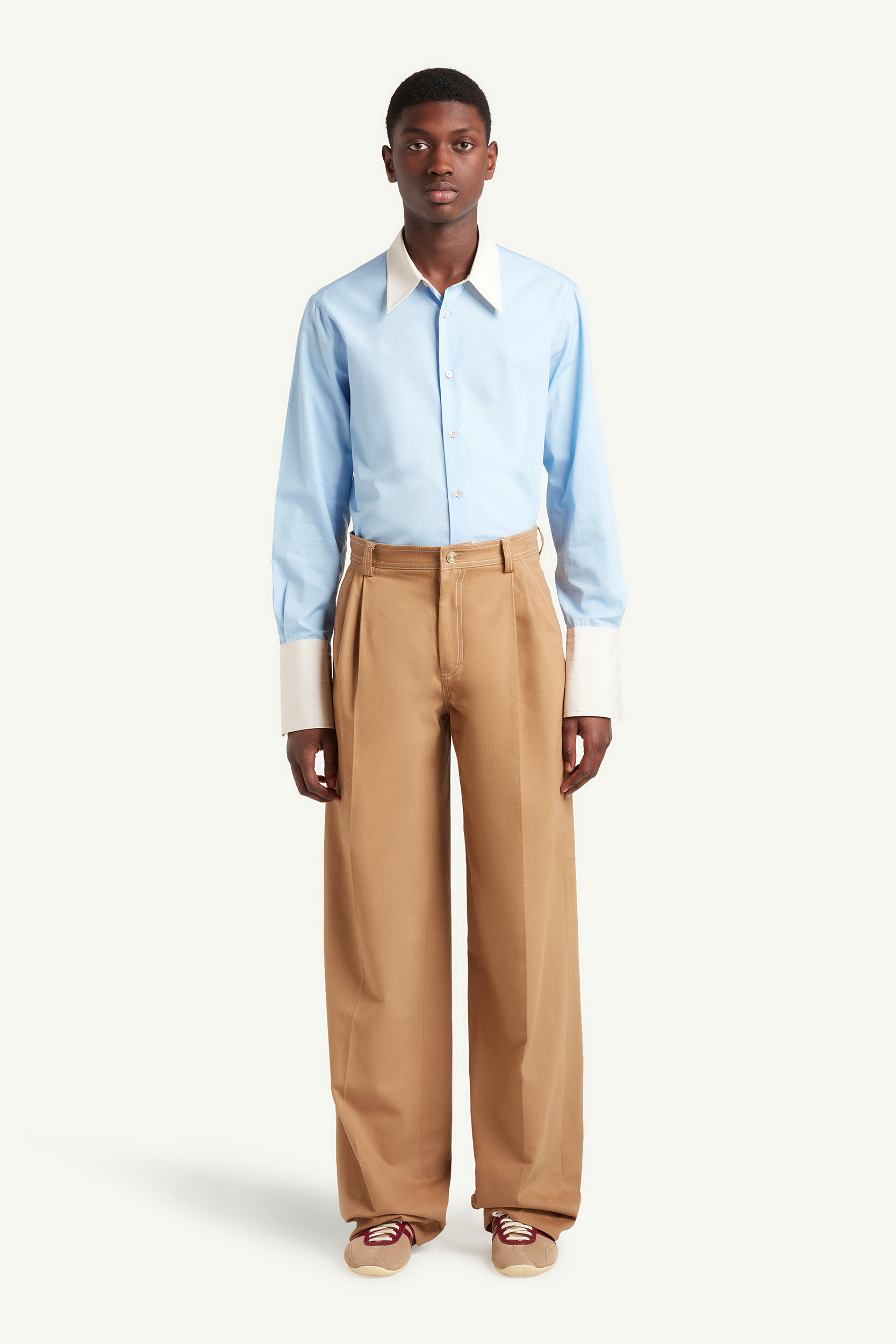 Menswear Model wearing light brown smart trousers with light blue top and white trainers  | eCommerce Photography London | LRP