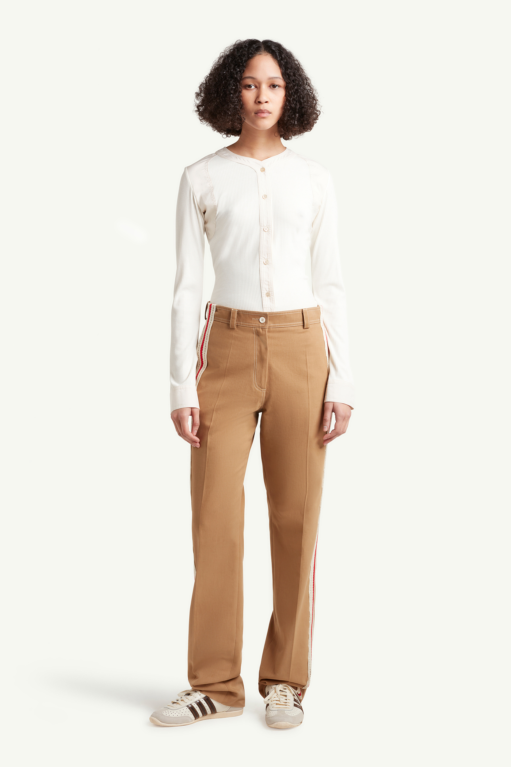 Womenswear Model wearing light brown smart trousers with white top and white trainers  | eCommerce Photography London | LRP