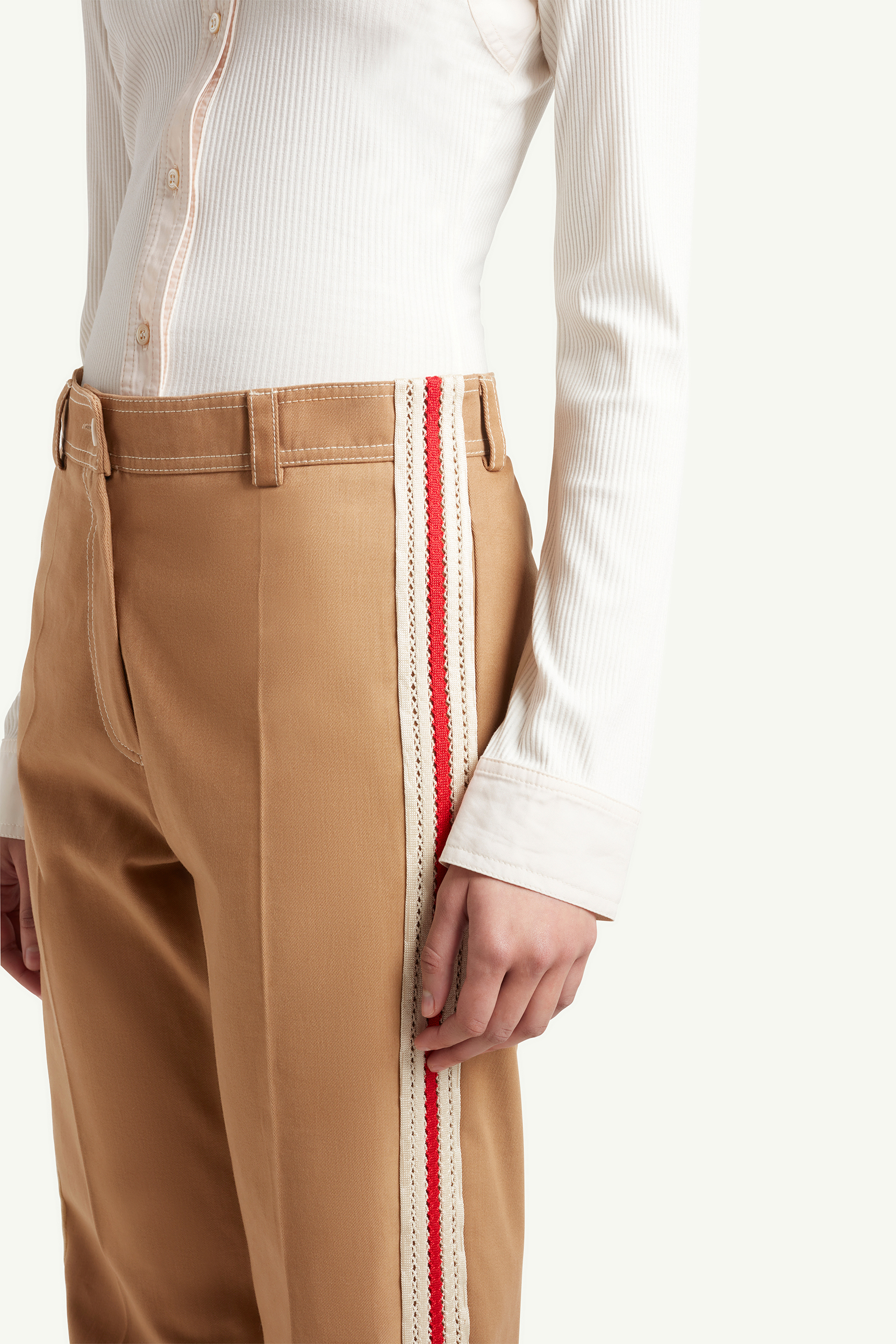 Close up shot of Wales Bonner light brown smart casual trousers with white top on womenswear model