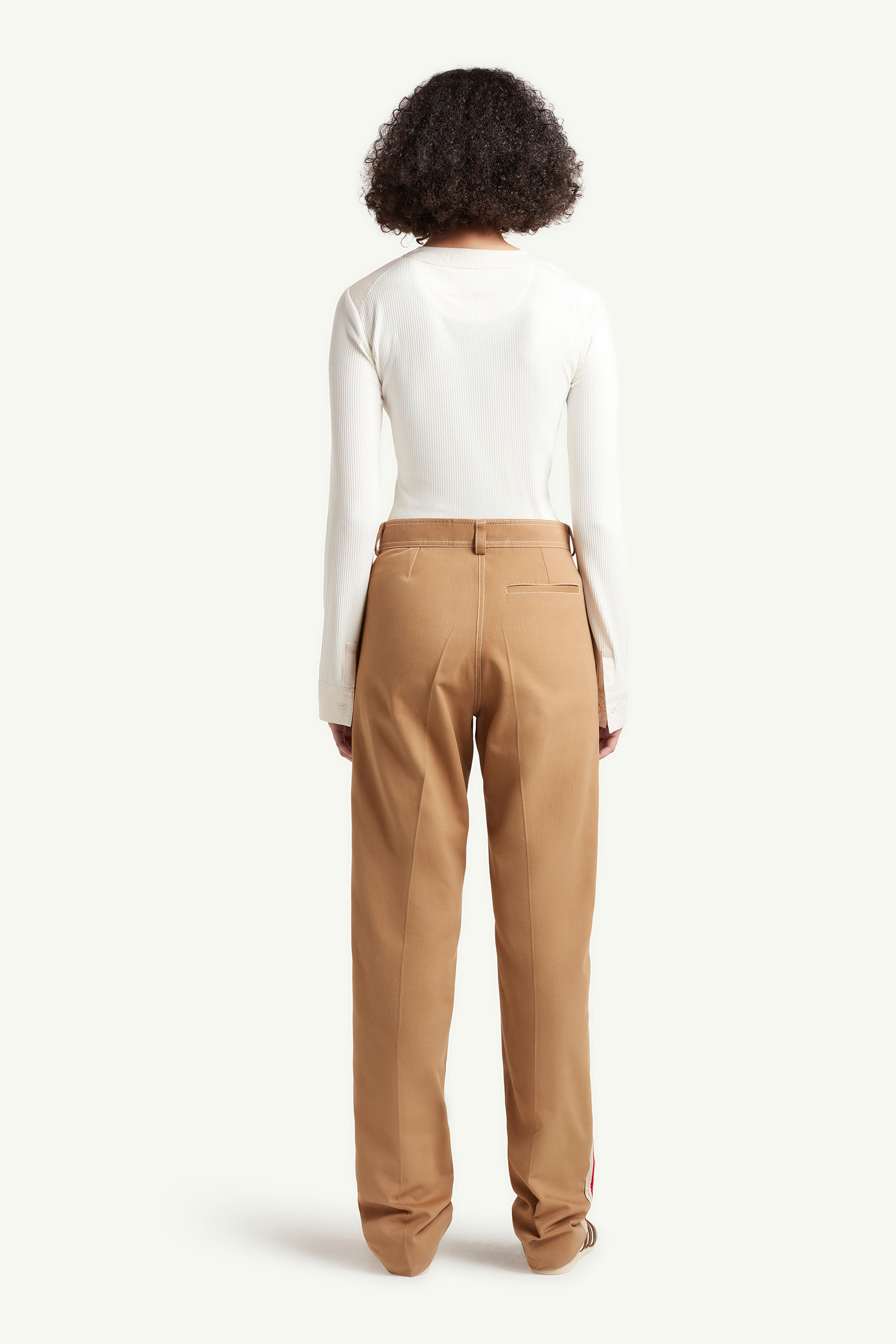 back shot of Womenswear Model wearing light brown smart trousers with white top and white trainers  | eCommerce Photography London | LRP