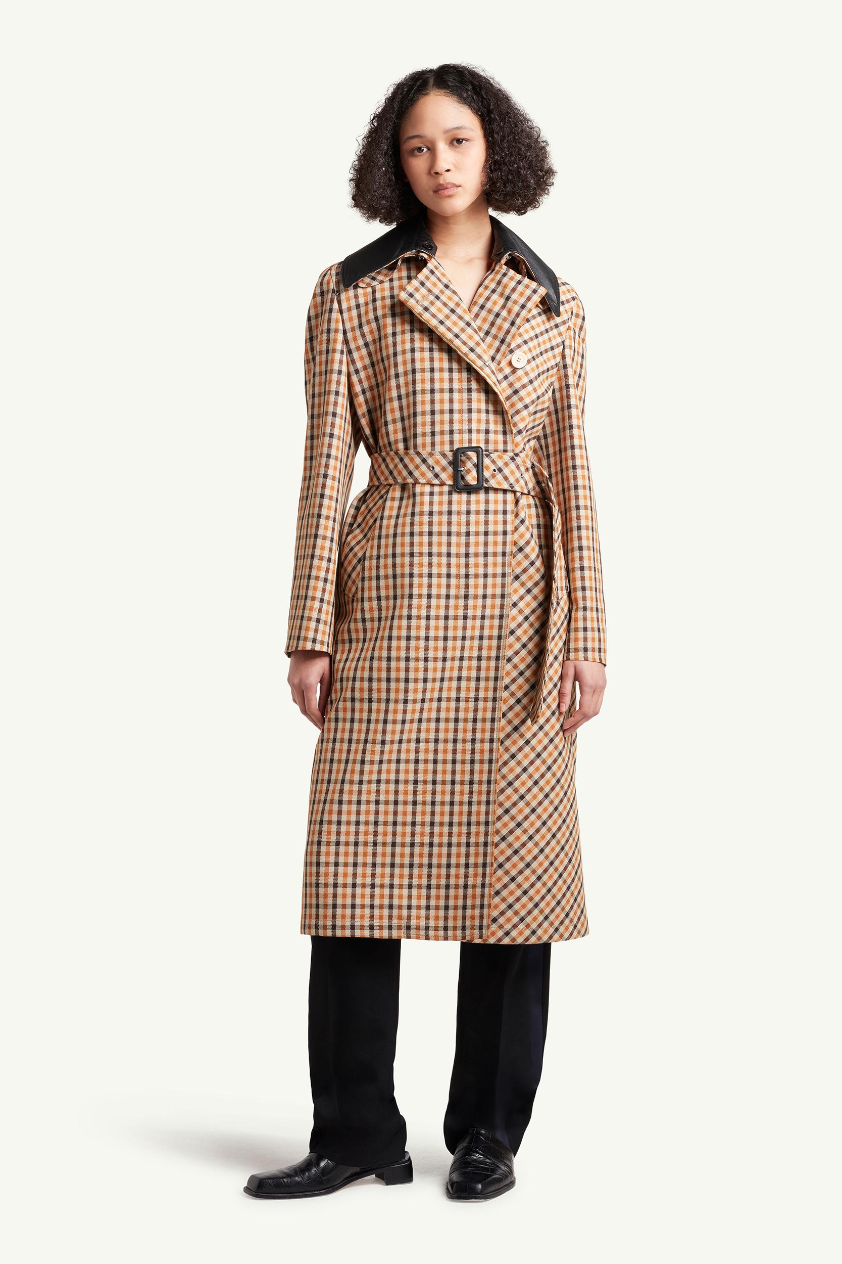 Womenswear model wearing light brown checkered Wales Bonner coat | e-Commerce Photography London | LRP