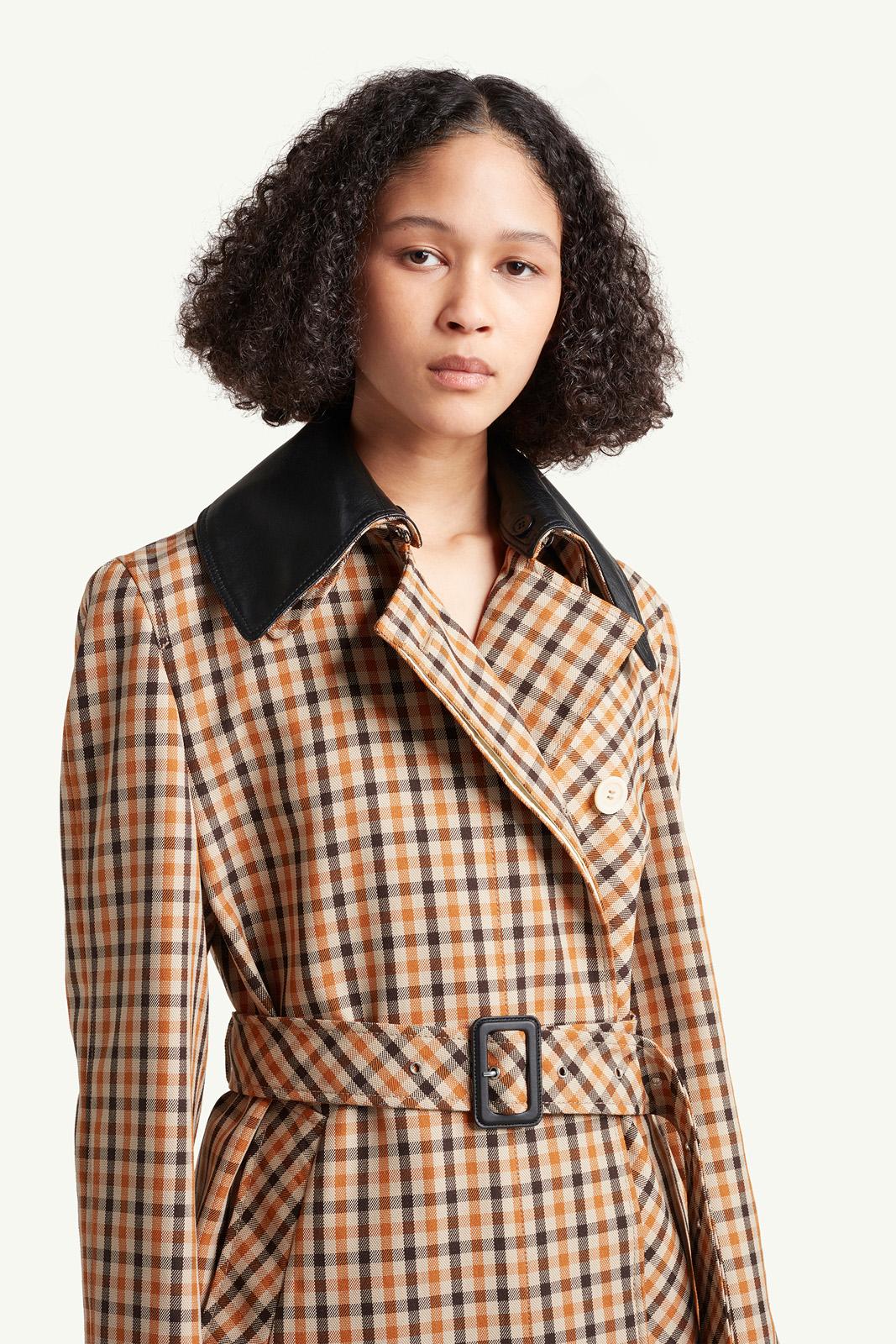 Portrait of Womenswear model wearing light brown checkered Wales Bonner coat | e-Commerce Photography London | LRP
