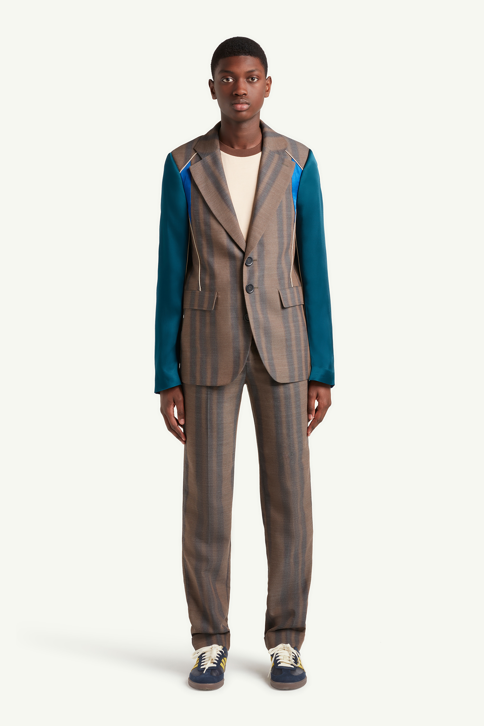 Menswear model wearing light grey, brown lined smart casual suit Wales Bonner | e-Commerce Photography London | LRP