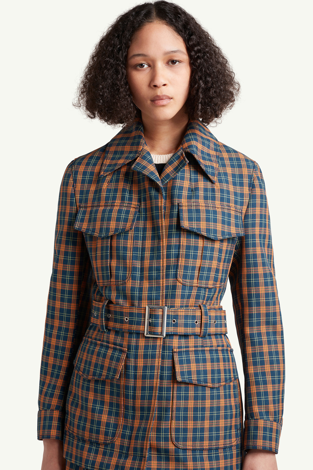 close up shot of Womenswear model wearing light grey, brown checkered jacket and skirt by Wales Bonner | e-Commerce Photography London | LRP