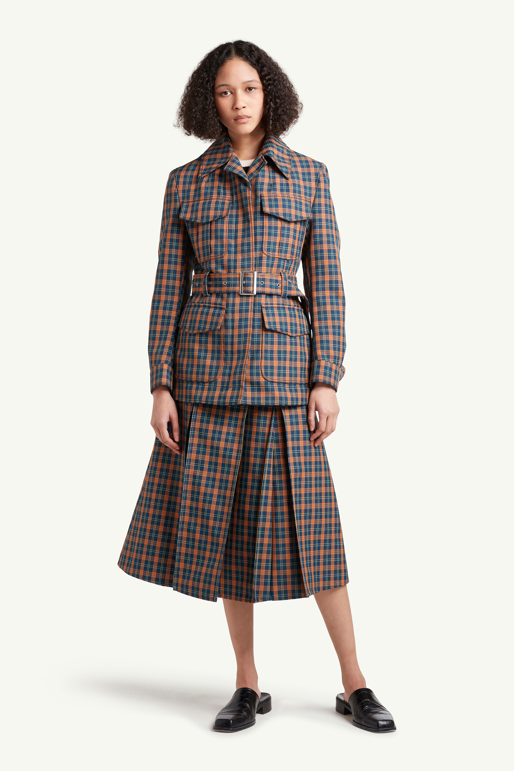 Womenswear model wearing light grey, brown checkered jacket and skirt by Wales Bonner | e-Commerce Photography London | LRP
