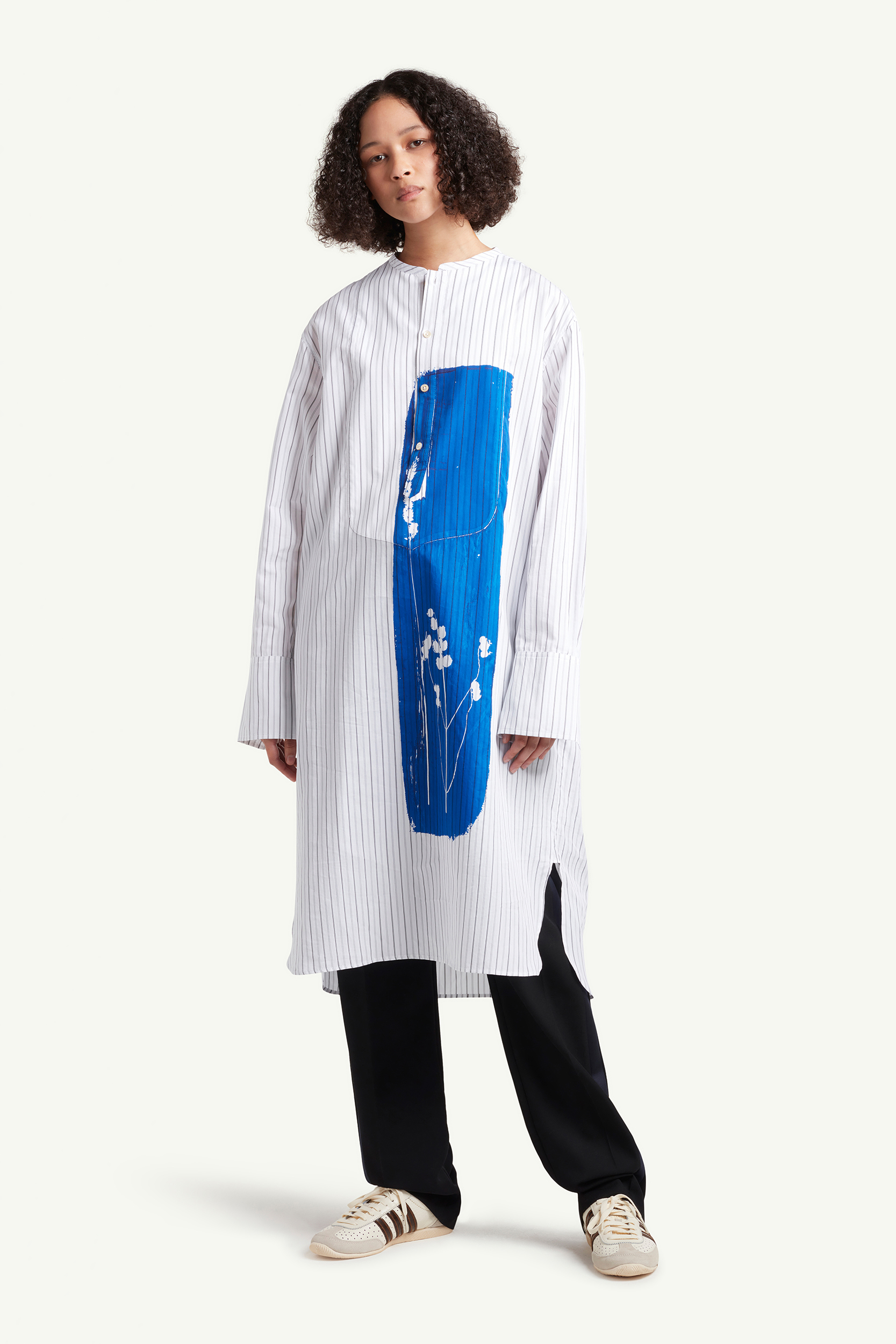Womenswear model wearing long white with blue graphic Wales Bonner shirt | eCommerce Photography London | LRP