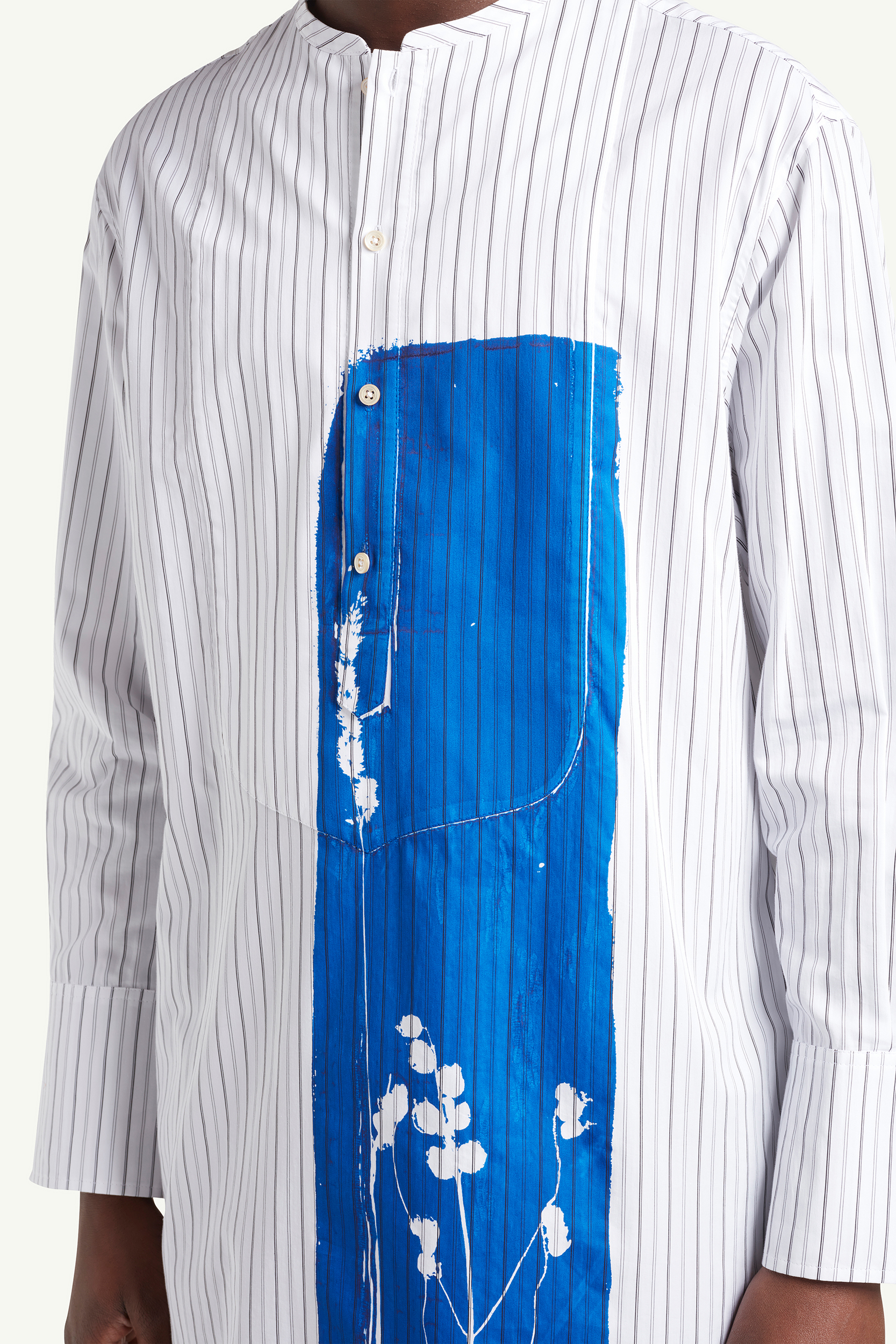 Close up detail shot of a long white with blue graphic Wales Bonner shirt | eCommerce Photography London | LRP