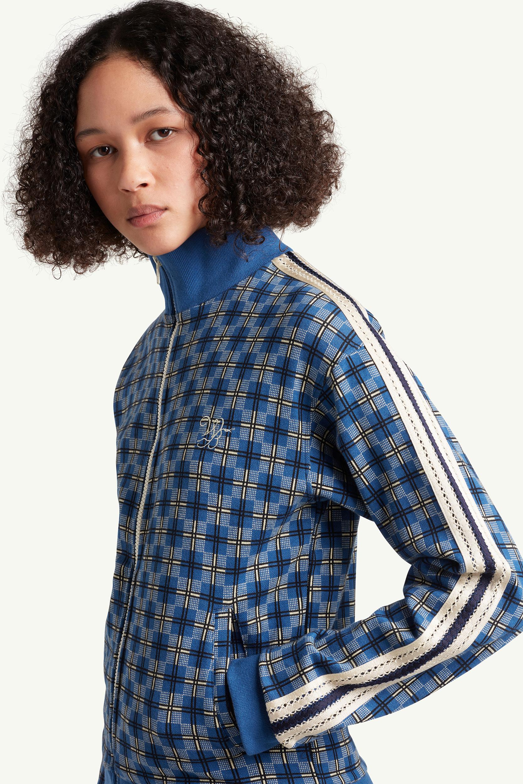 Womenswear model wearing blue pattern track top by Wales Bonner