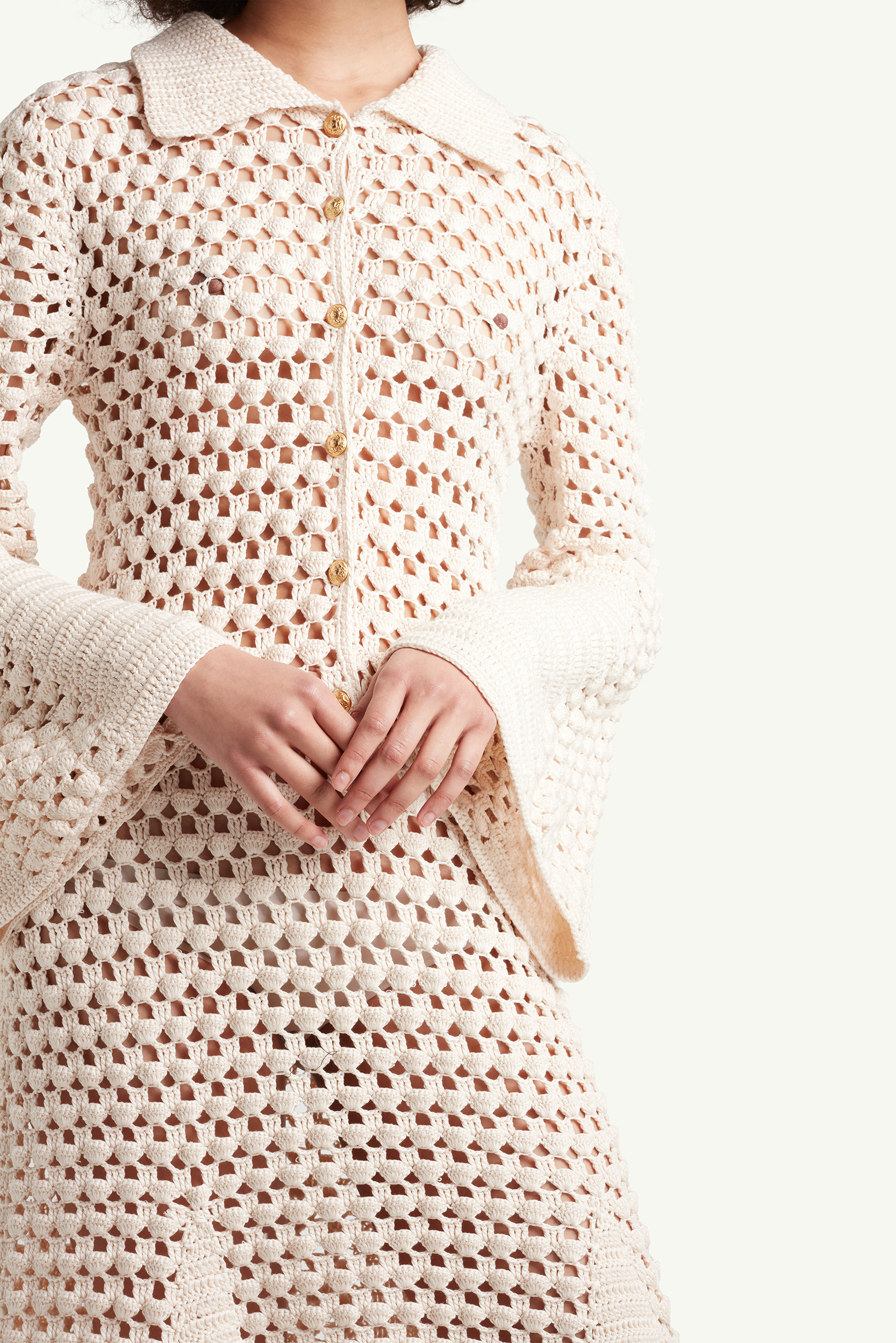 detail shot of the Wales Bonner Womenswear Model wearing a white see-through knitted dress | LRP
