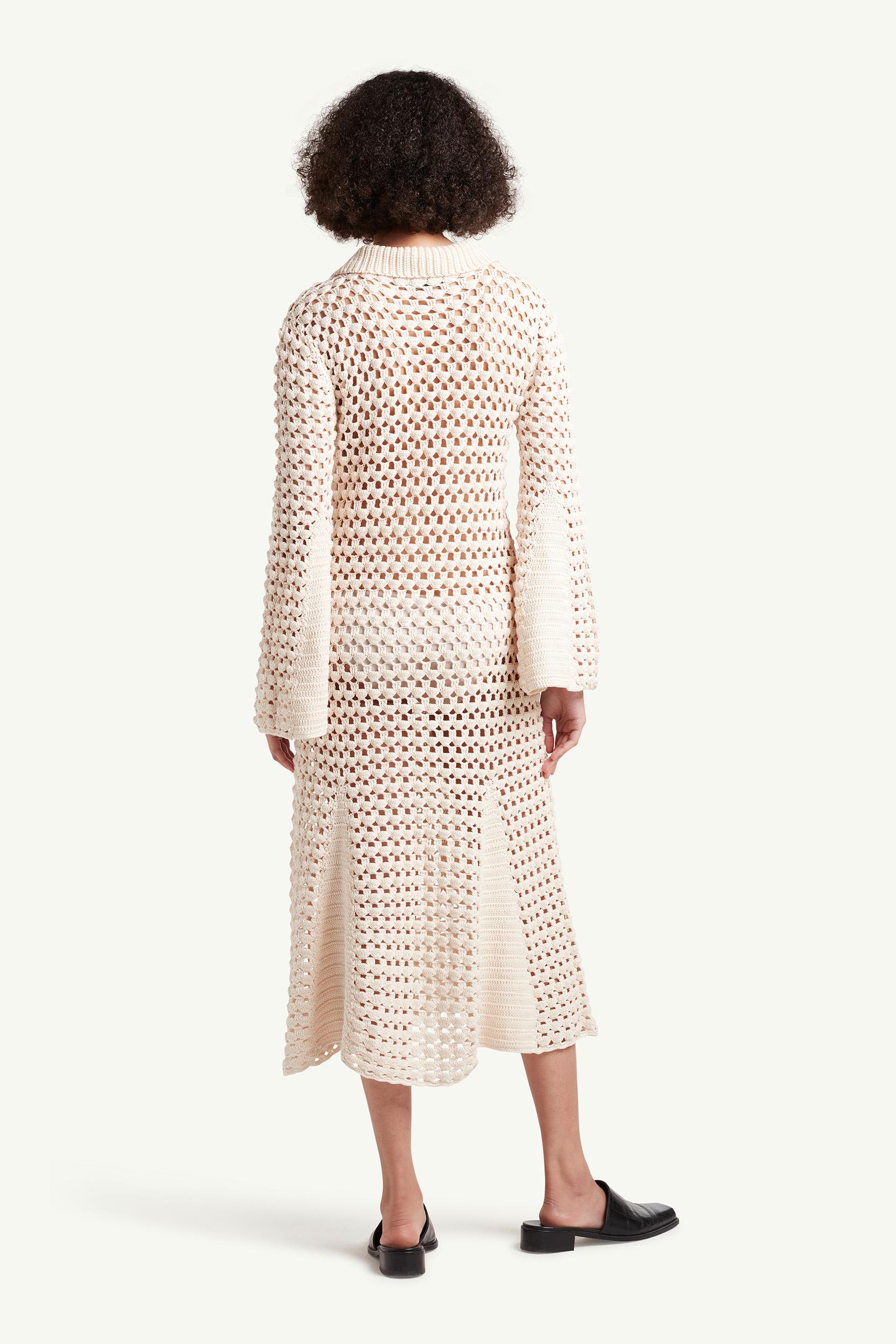 Back side shot of womenswear model wearing Wales Bonner Womenswear Model wearing a white see-through knitted dress | LRP
