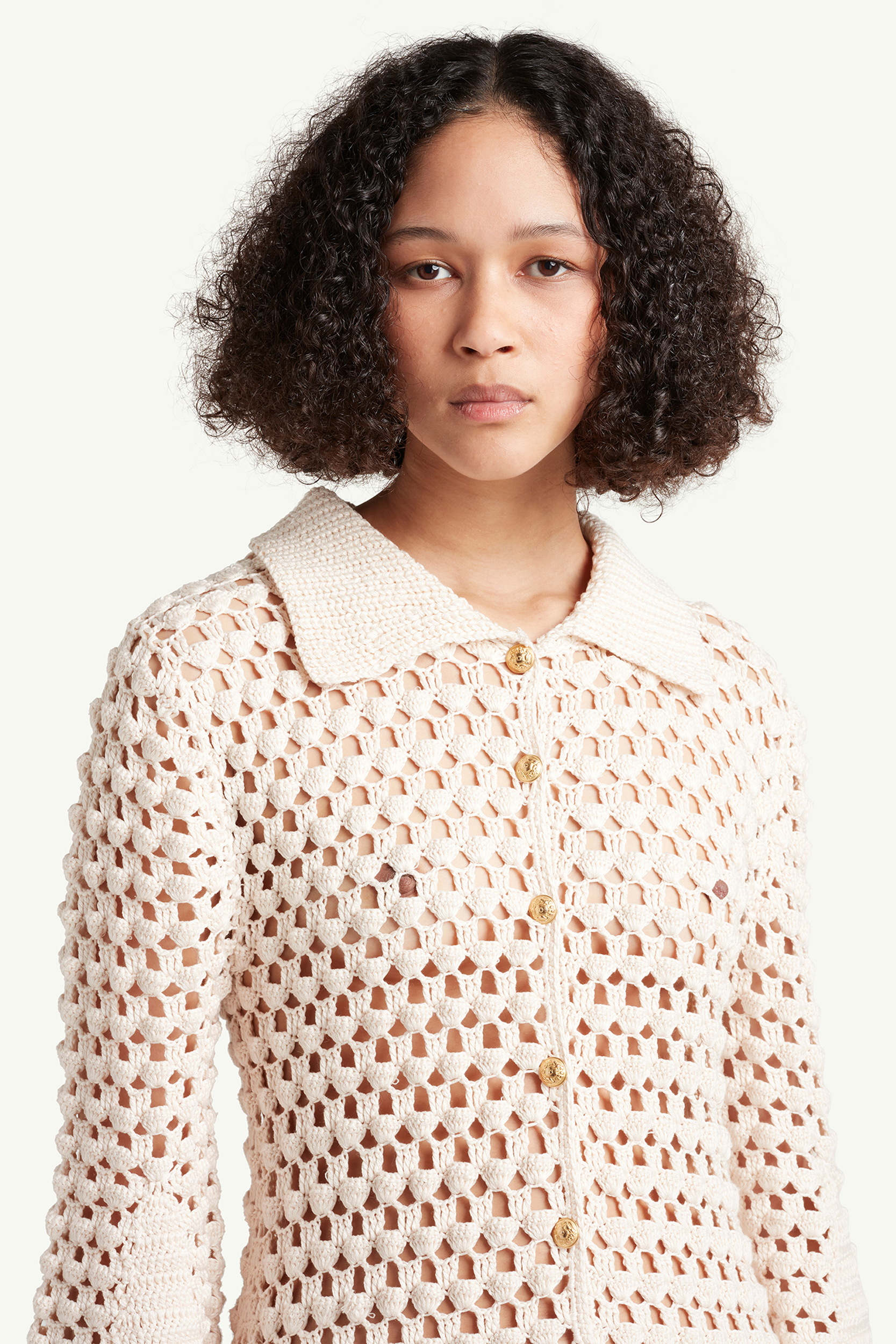 Womenswear model portrait shot wearing Wales Bonner Womenswear Model wearing a white see-through knitted dress | ecommerce photography London