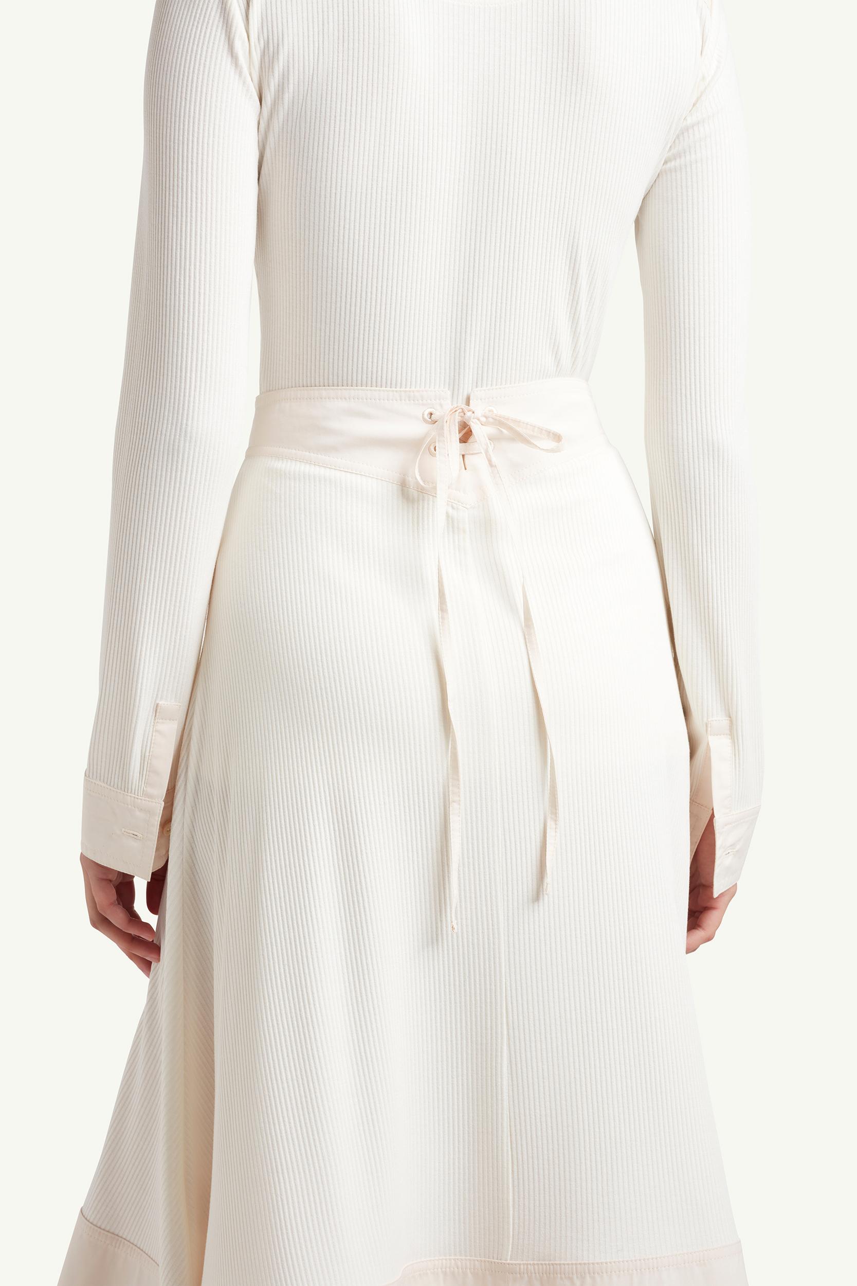 back side detail shot of womenswear model wearing Wales Bonner Womenswear Model wearing a white long dress | LRP